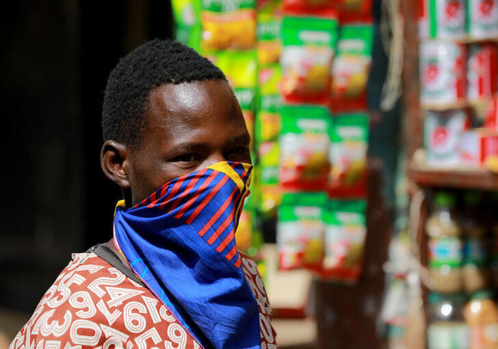 A man wears a face mask at Dutse Alhaji market, as authorities race to contain the coronavirus disease (COVID-19) in Abuja, Nigeria May 2, 2020. REUTERS/Afolabi Sotunde