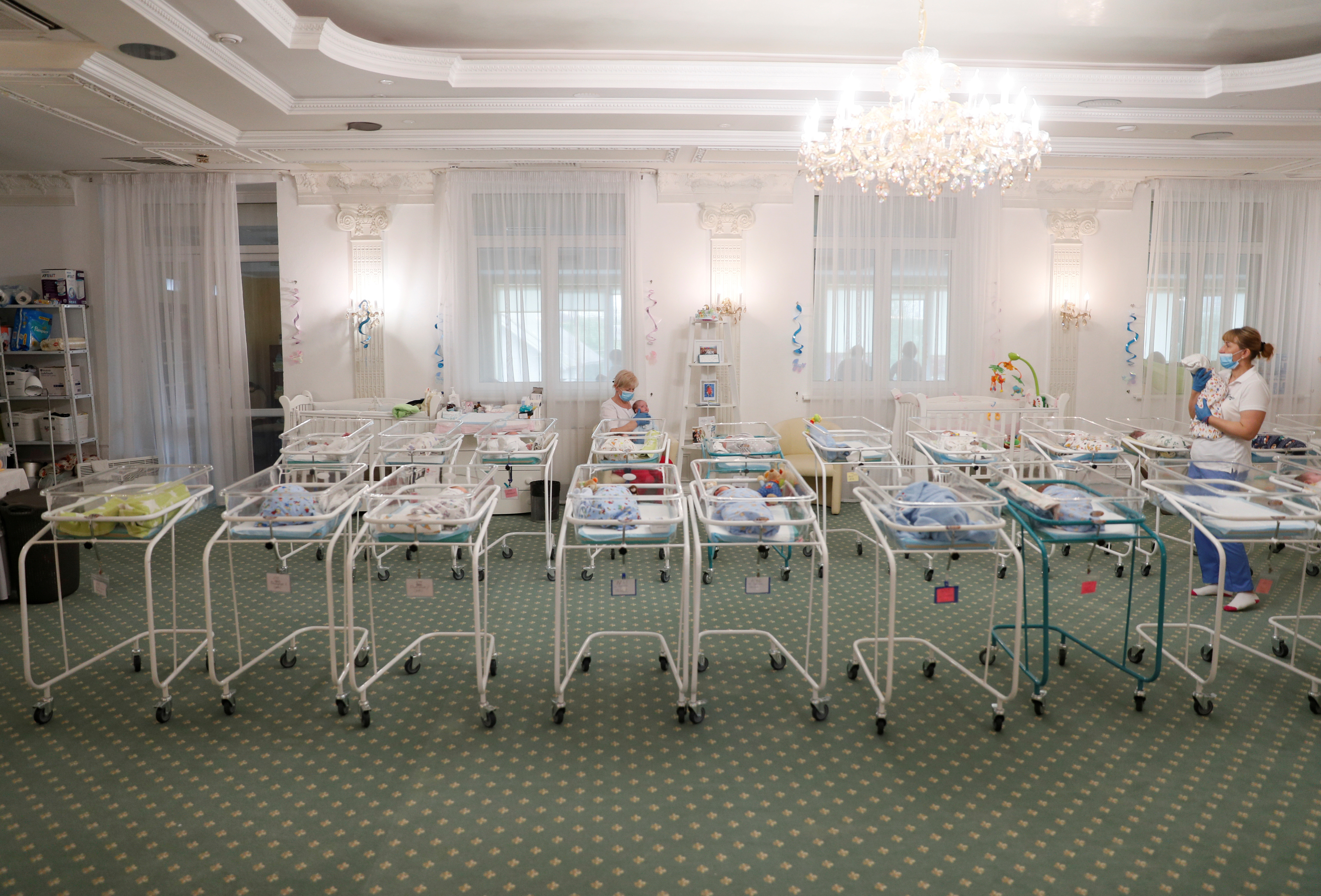 A view shows nurses and newborns in the Hotel Venice owned by BioTexCom clinic in Kiev, Ukraine May 14, 2020. At least fifty babies born to surrogate mothers are stranded in a Ukrainian clinic as the coronavirus disease (COVID-19) lockdown prevents their foreign parents from collecting them. Picture taken May 14, 2020. REUTERS/Gleb Garanich     TPX IMAGES OF THE DAY - RC2KOG9O3GQM