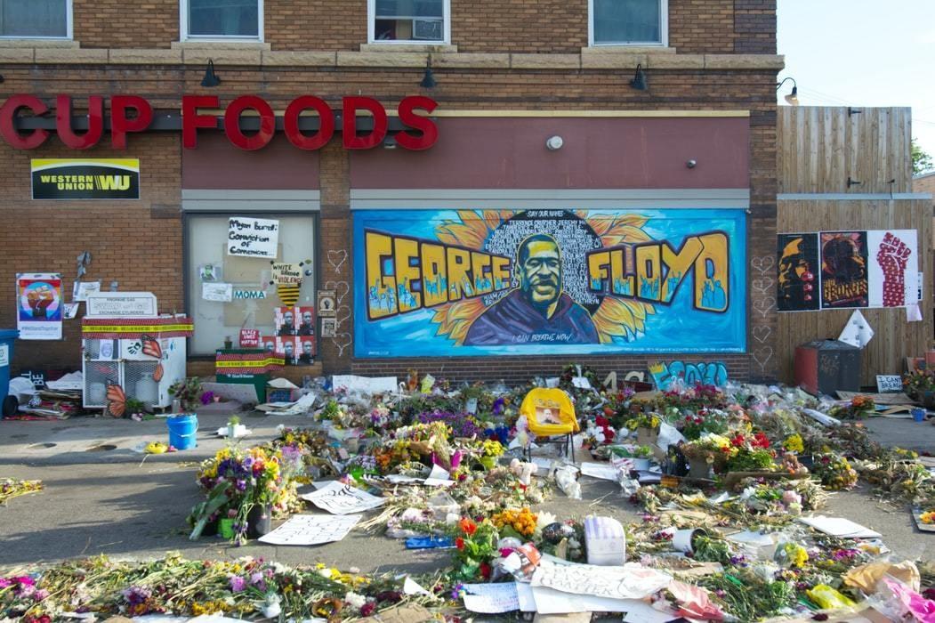 image of flowers left by a George Floyd memorial