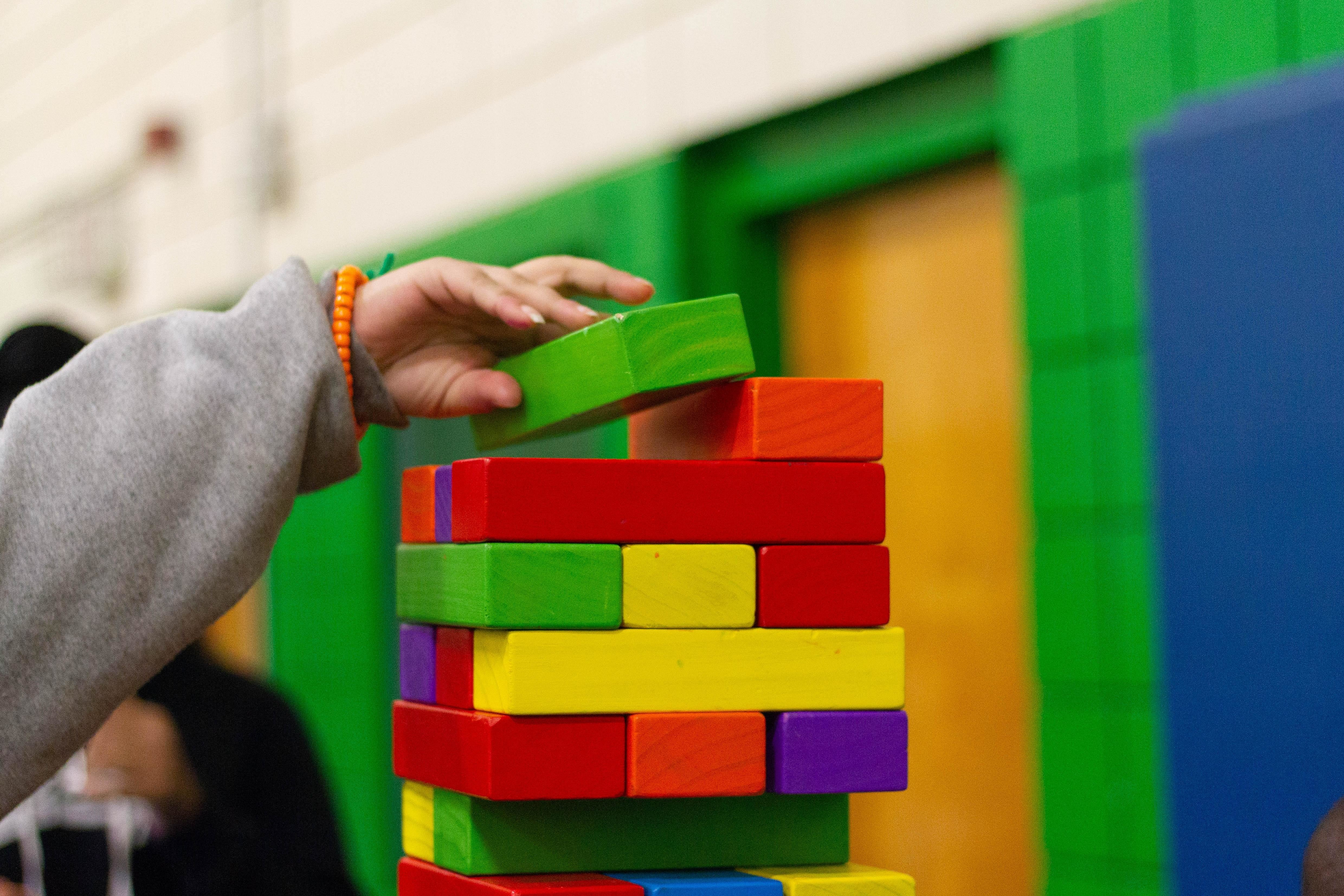 shown here is a child playing with building blocks. Researchers have been studying how children playing in educational, public spaces can help their development i