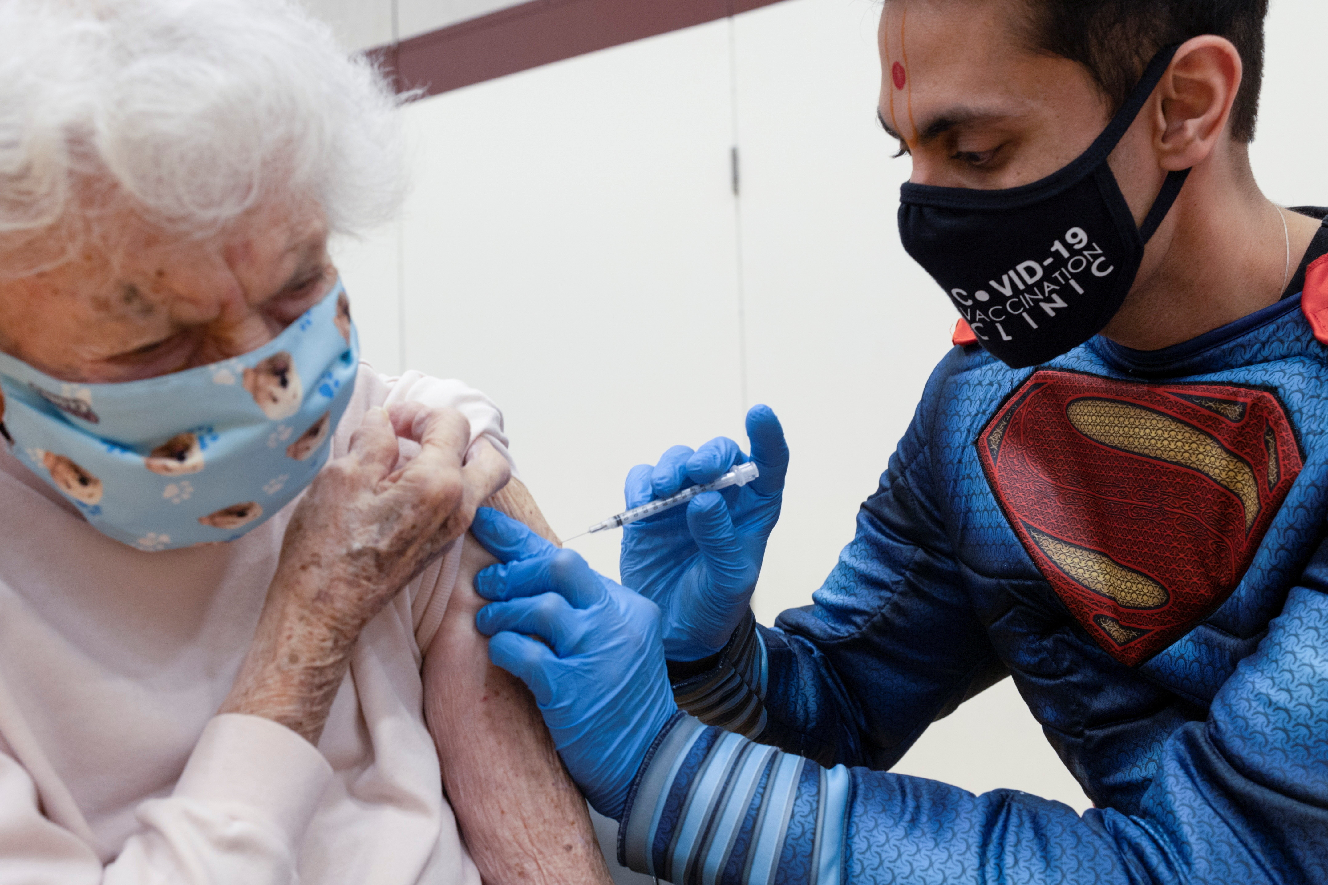 Dr. Mayank Amin administers the Pfizer-BioNTech coronavirus disease (COVID-19) vaccine to Helen Pepe, 94, at a clinic ran by Skippack Pharmacy in Collegeville, Pennsylvania, U.S., March 7, 2021.  Picture taken March 7, 2021.  REUTERS/Hannah Beier     TPX IMAGES OF THE DAY - RC2C8M97C15J