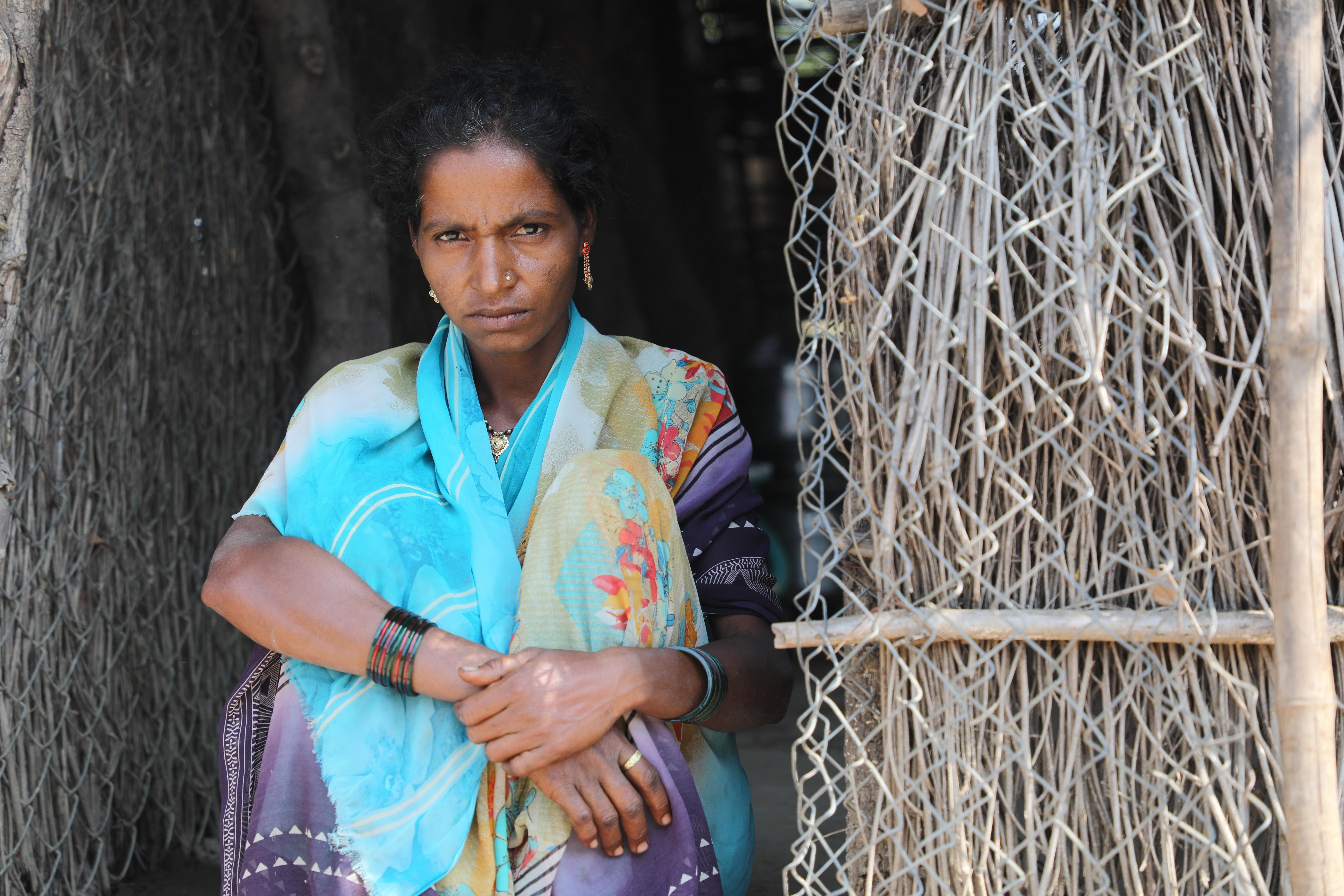 women, like this woman here, bear the brunt of global crises such as COVID-19 and climate change