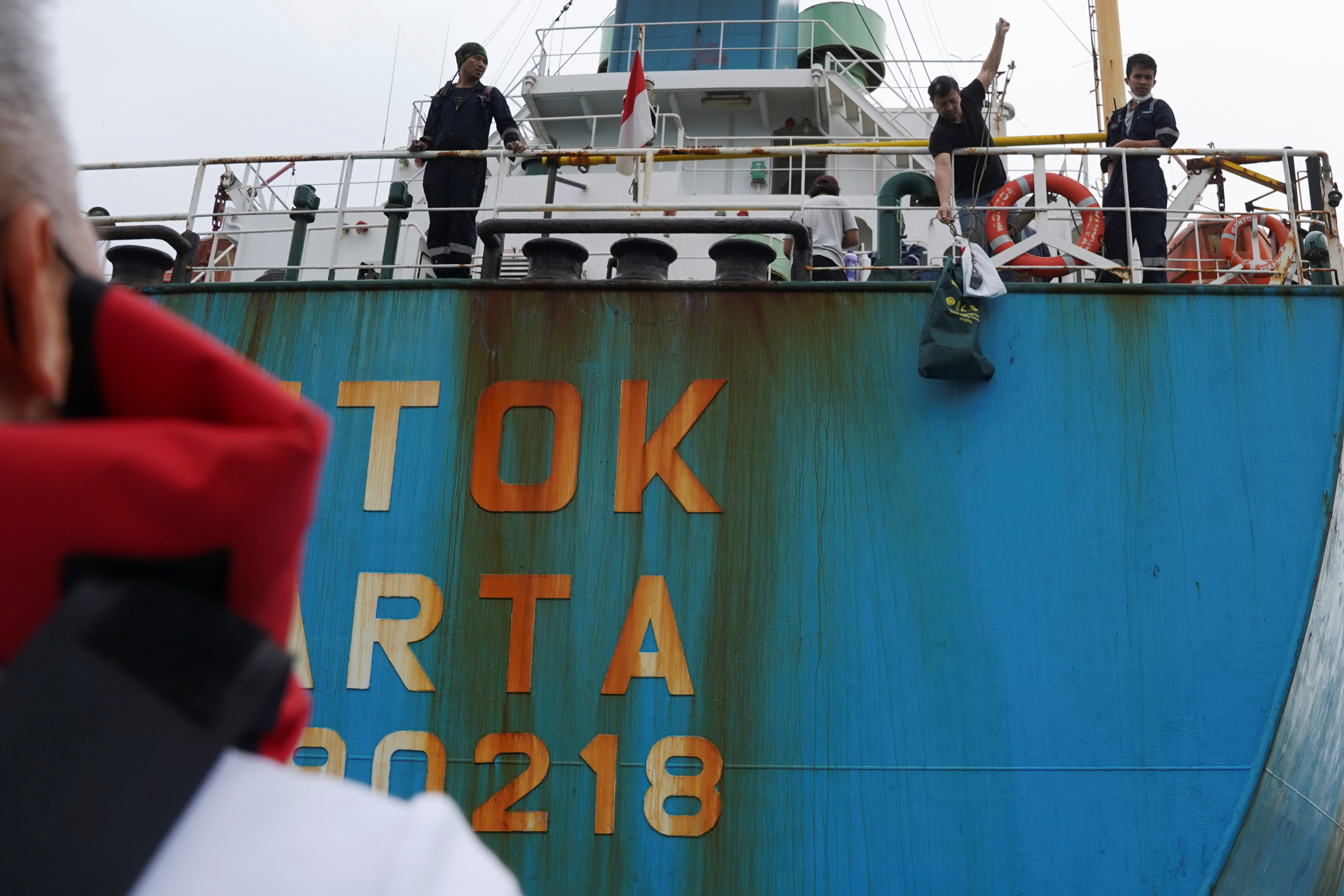 A sailor on an Indonesia-flagged cement carrier pulls a bag as the Mission of Seafarers delivers supplies to sailors stranded on visiting cargo vessels due to the coronavirus disease (COVID-19) pandemic, in Hong Kong, China March 22, 2021. Picture taken March 22, 2021.