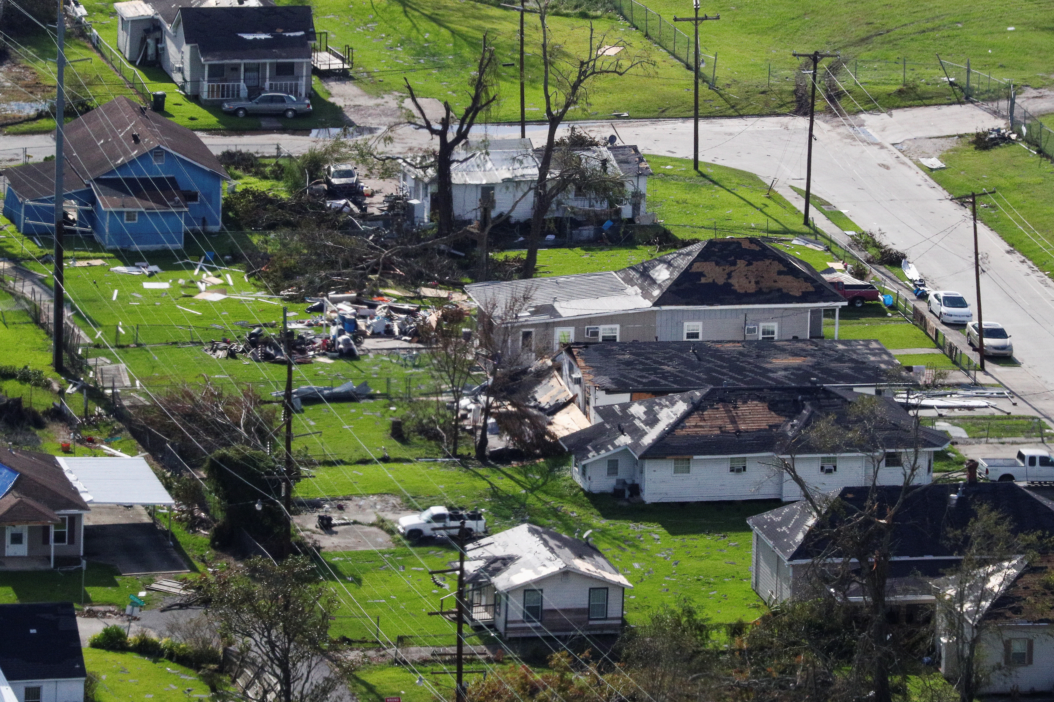 An aerial view shows debris and houses damaged by Hurricane Laura near Lake Charles, Louisiana, U.S., August 29, 2020.  REUTERS/Tom Brenner - RC21OI9IGAC7