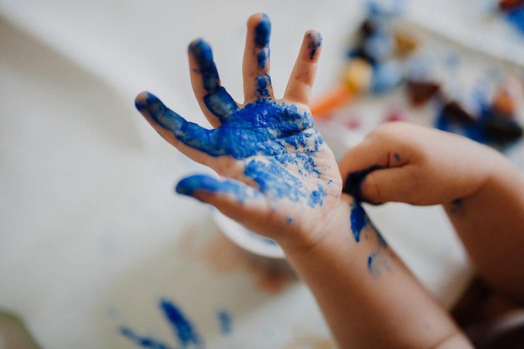 image of a child's hand painting