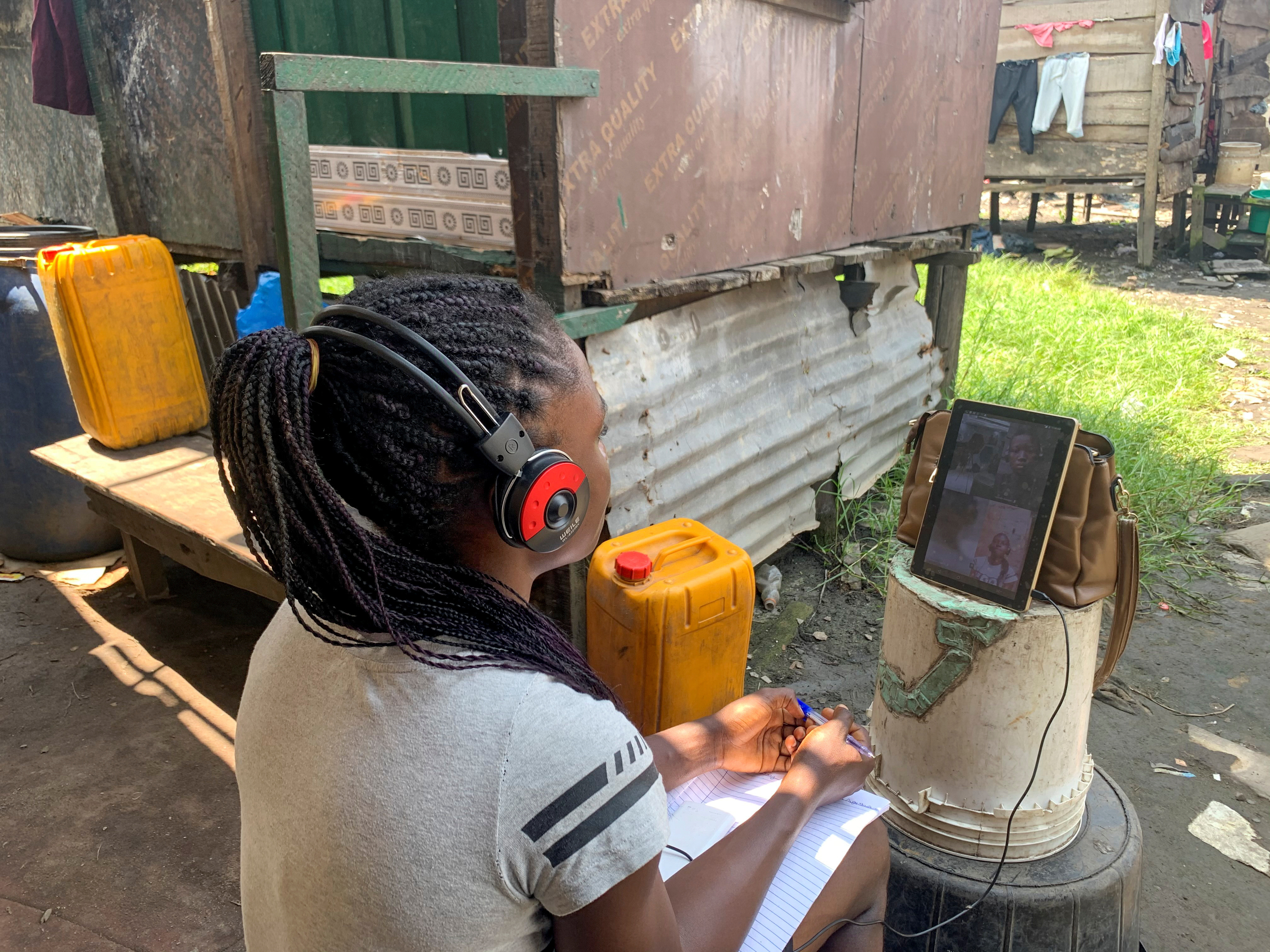 Esther Ikechukwu, a beneficiary of Slum2School project, attends a virtual class from her home in Makoko, Lagos, Nigeria August 19, 2020. Picture taken August 19, 2020. REUTERS/Nneka Chile - RC2XUI9K1Q07