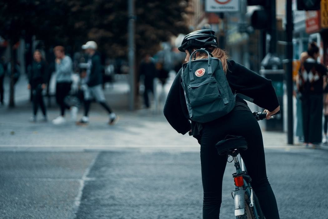 Women cycling in city, a form of exercise increasing during the COVID-19 pandemic.