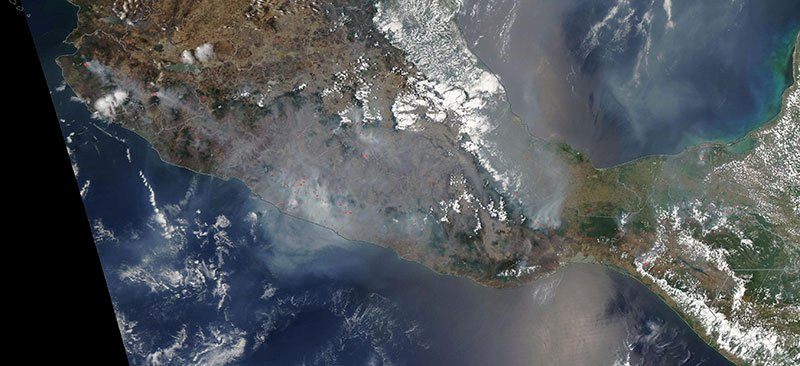 Smoke and fires in Southern Mexico are observed in this image taken by the NASA Aqua MODIS satellite on May 12, 2019. Picture taken May 12, 2019.   Courtesy NASA/Handout via REUTERS  ATTENTION EDITORS - THIS IMAGE HAS BEEN SUPPLIED BY A THIRD PARTY. - RC1EFC446700