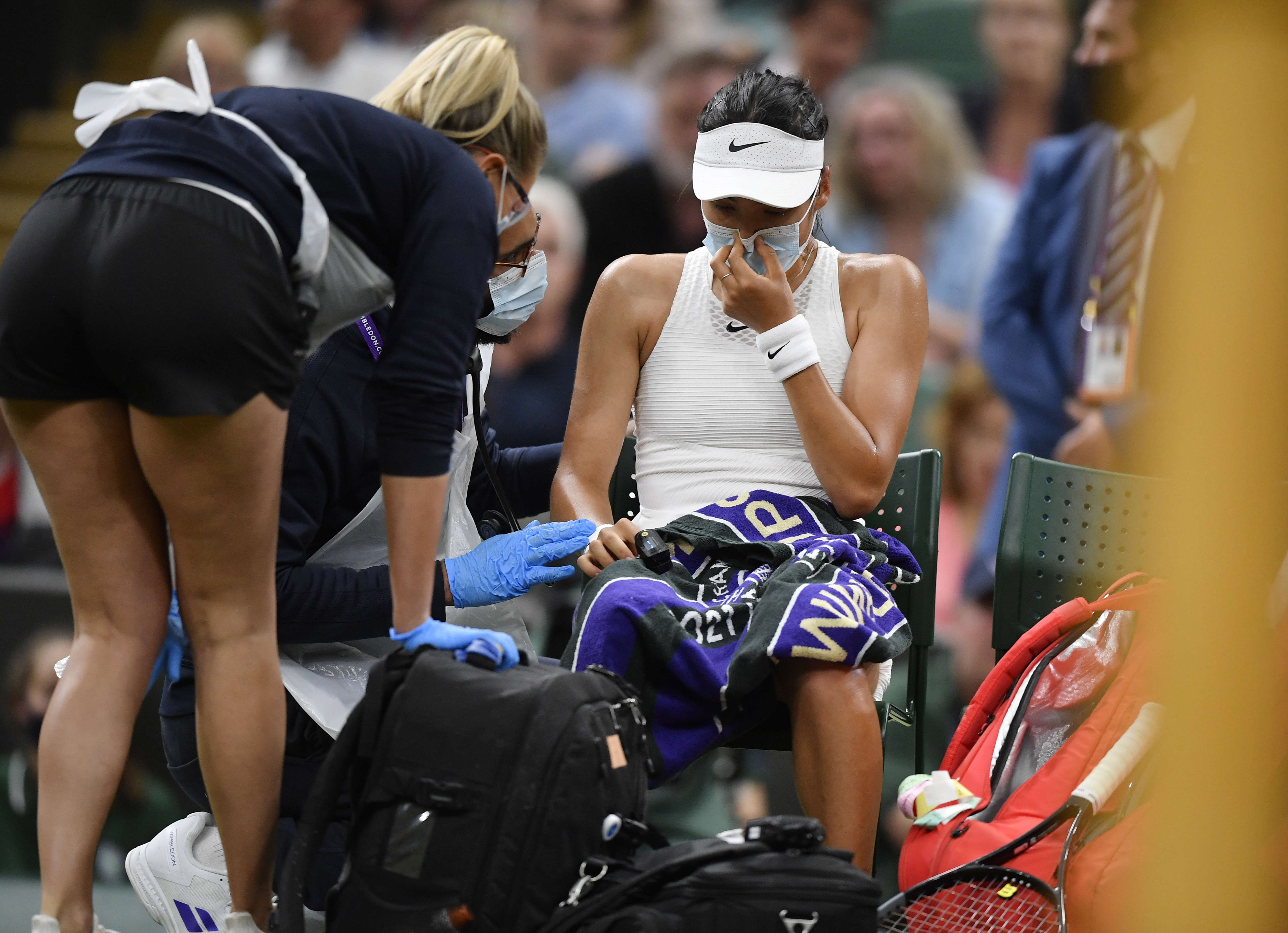 Tennis - Wimbledon - All England Lawn Tennis and Croquet Club, London, Britain - July 5, 2021 Britain's Emma Raducanu receives medical attention during her fourth round match against Australia's Ajla Tomljanovic