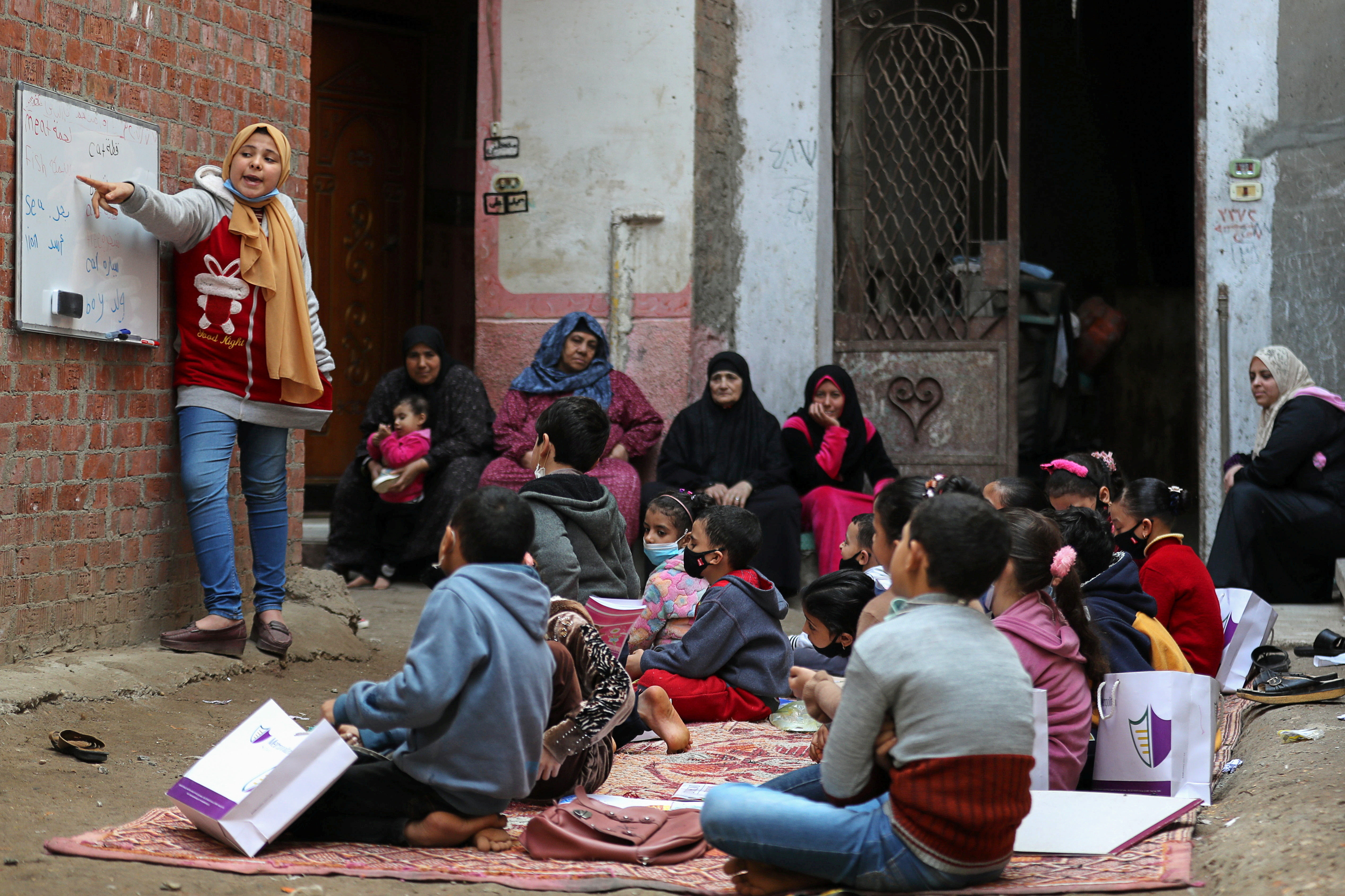 Reem El-Khouly, a 12-year-old girl, teaches children in her neighborhood as schools remain closed during the coronavirus disease (COVID-19) pandemic, at Atmida village in Dakahlia province, Egypt February 7, 2021. Picture taken February 7, 2021.