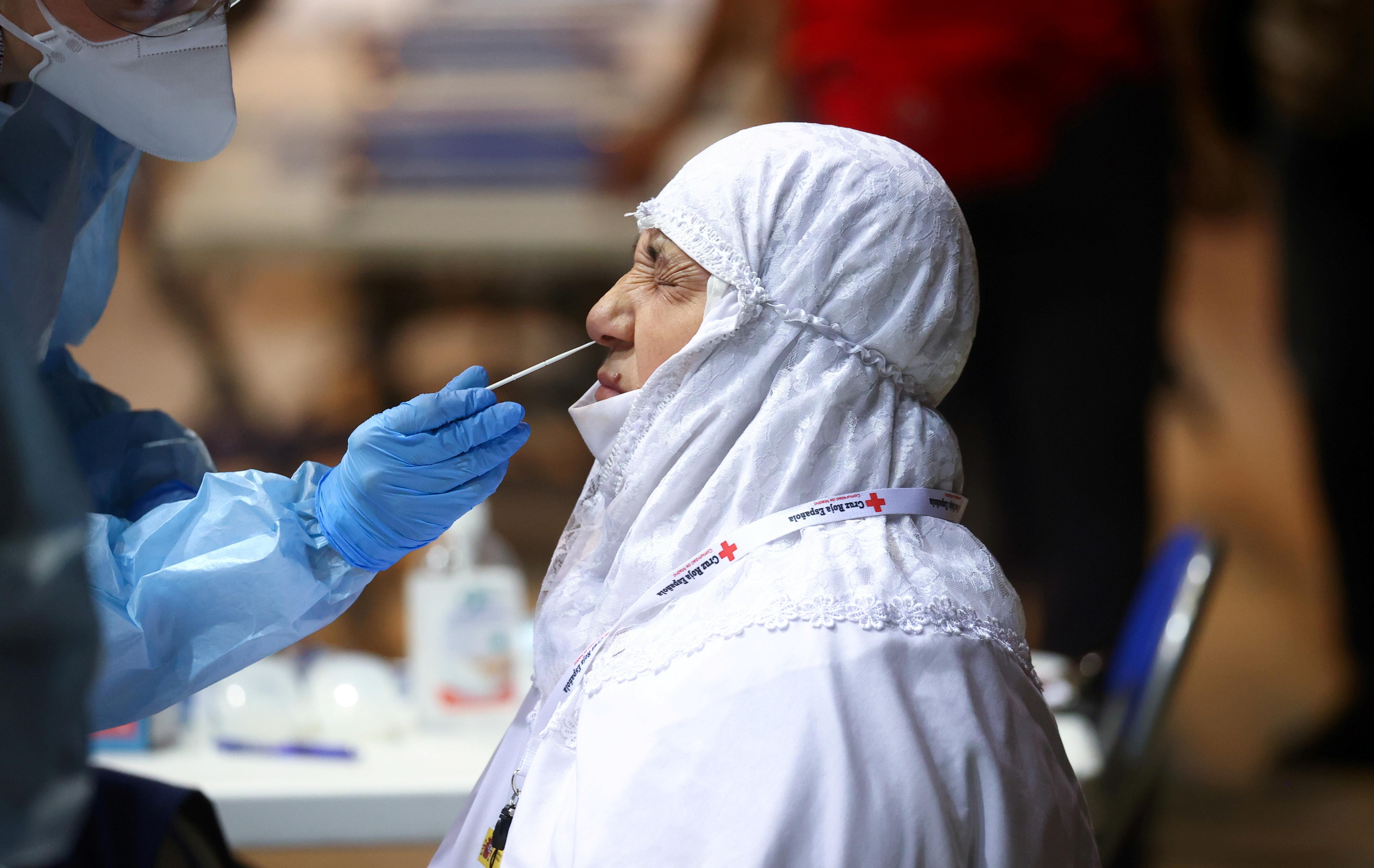 An evacuee reacts during coronavirus disease (COVID-19) tests