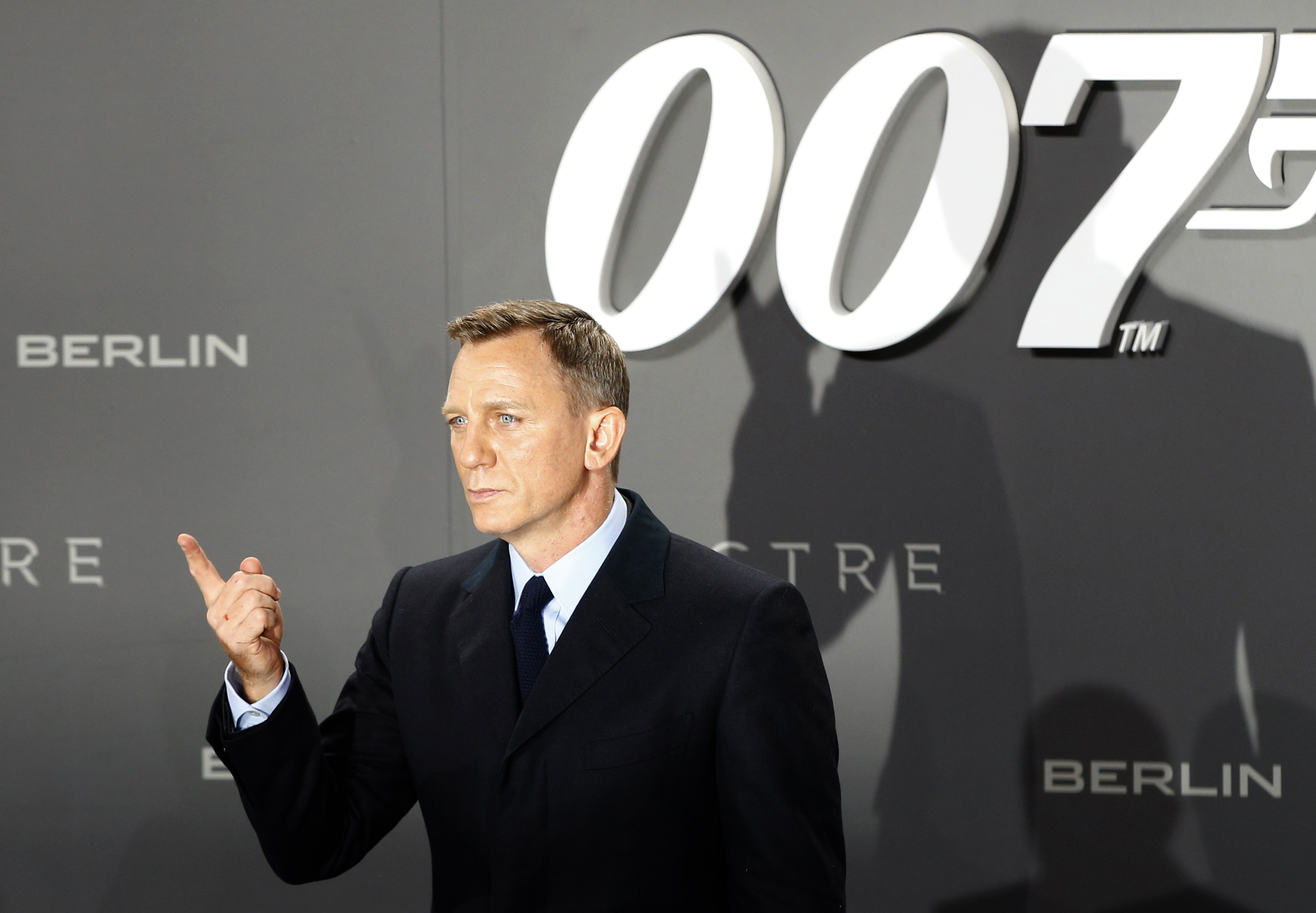 Actor Daniel Craig poses for photographers on the red carpet at the premiere of a James Bond film.
