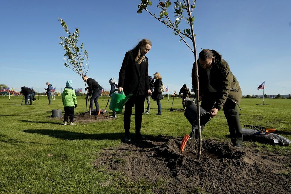 People plant trees in the Happy Tree park on World Cleanup Day in Jelgava, Latvia September 18, 2021.