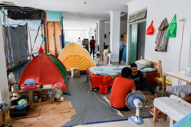 Camping tents are set up inside a former military building that is used as a temporary shelter for refugees, with most coming from Afghanistan, in Jakarta, Indonesia, August 31, 2021. REUTERS/Willy Kurniawan