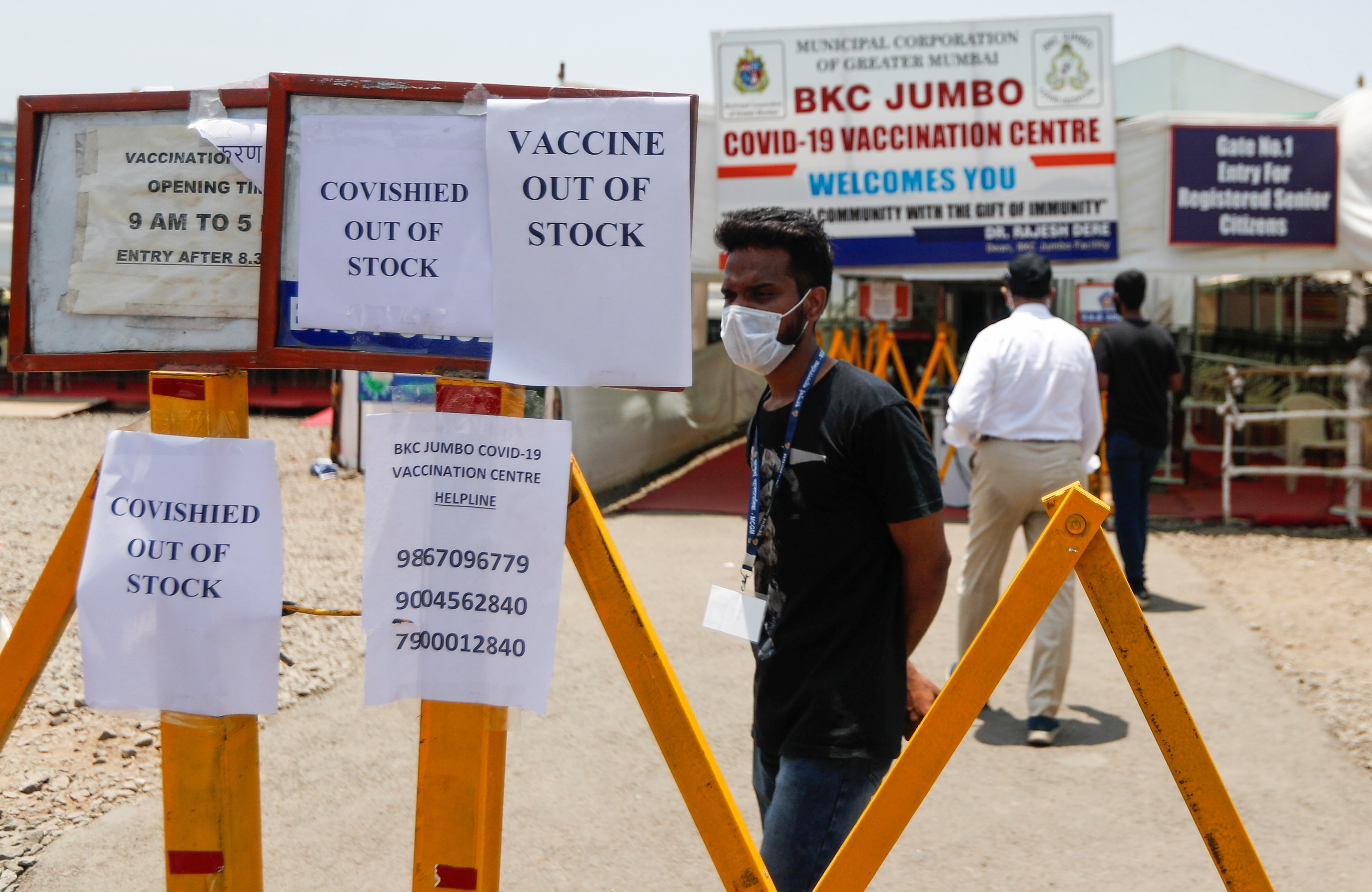 Notices about the shortage of COVISHIELD, a coronavirus disease (COVID-19) vaccine manufactured by Serum Institute of India, are seen outside a COVID-19 vaccination centre in Mumbai, India