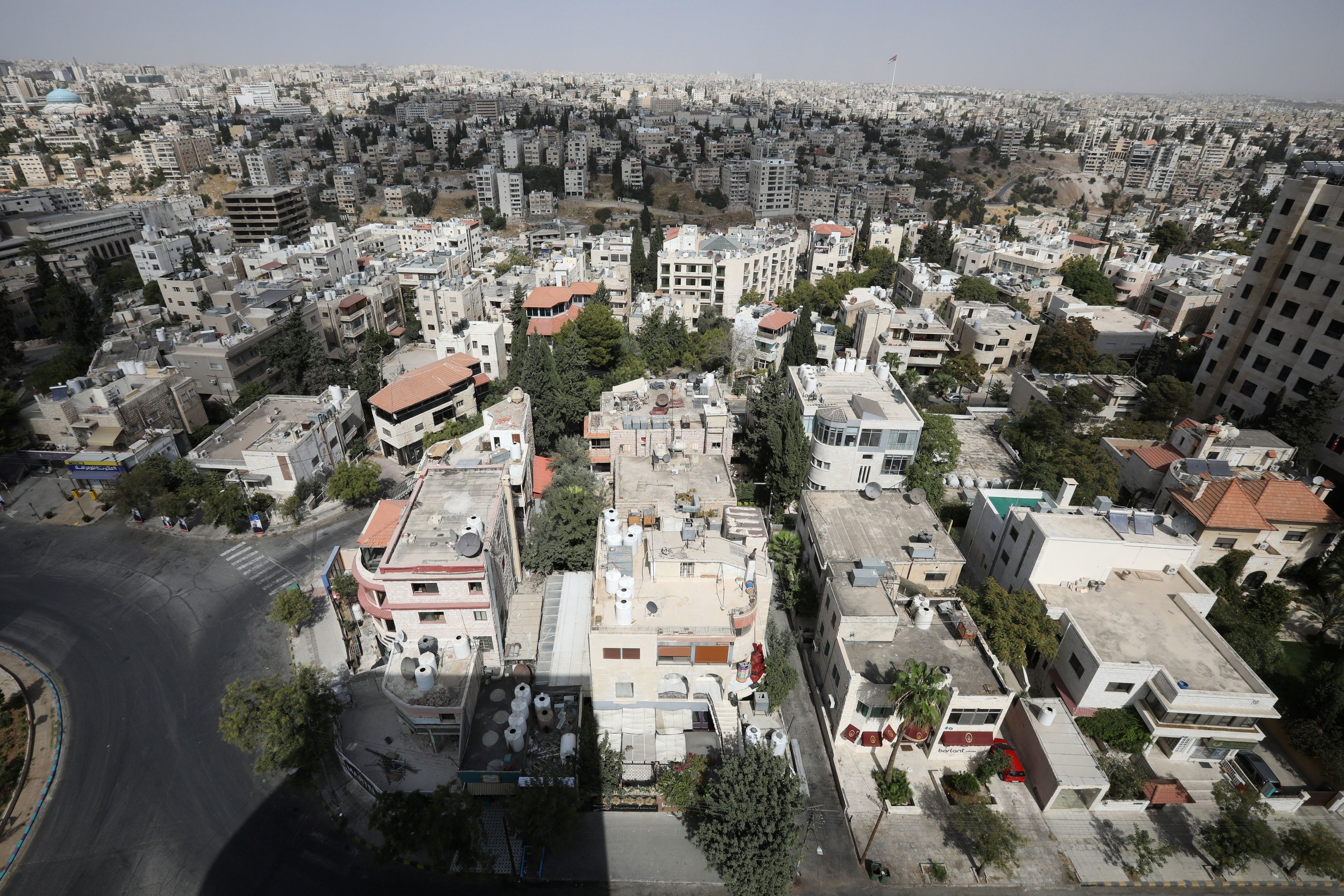 General view showing empty streets, during the nationwide curfew for two days, amid fears of a rising number of coronavirus disease (COVID-19) cases in Amman, Jordan October 9, 2020. REUTERS/Muhammad Hamed - RC2ZEJ9FAR0G