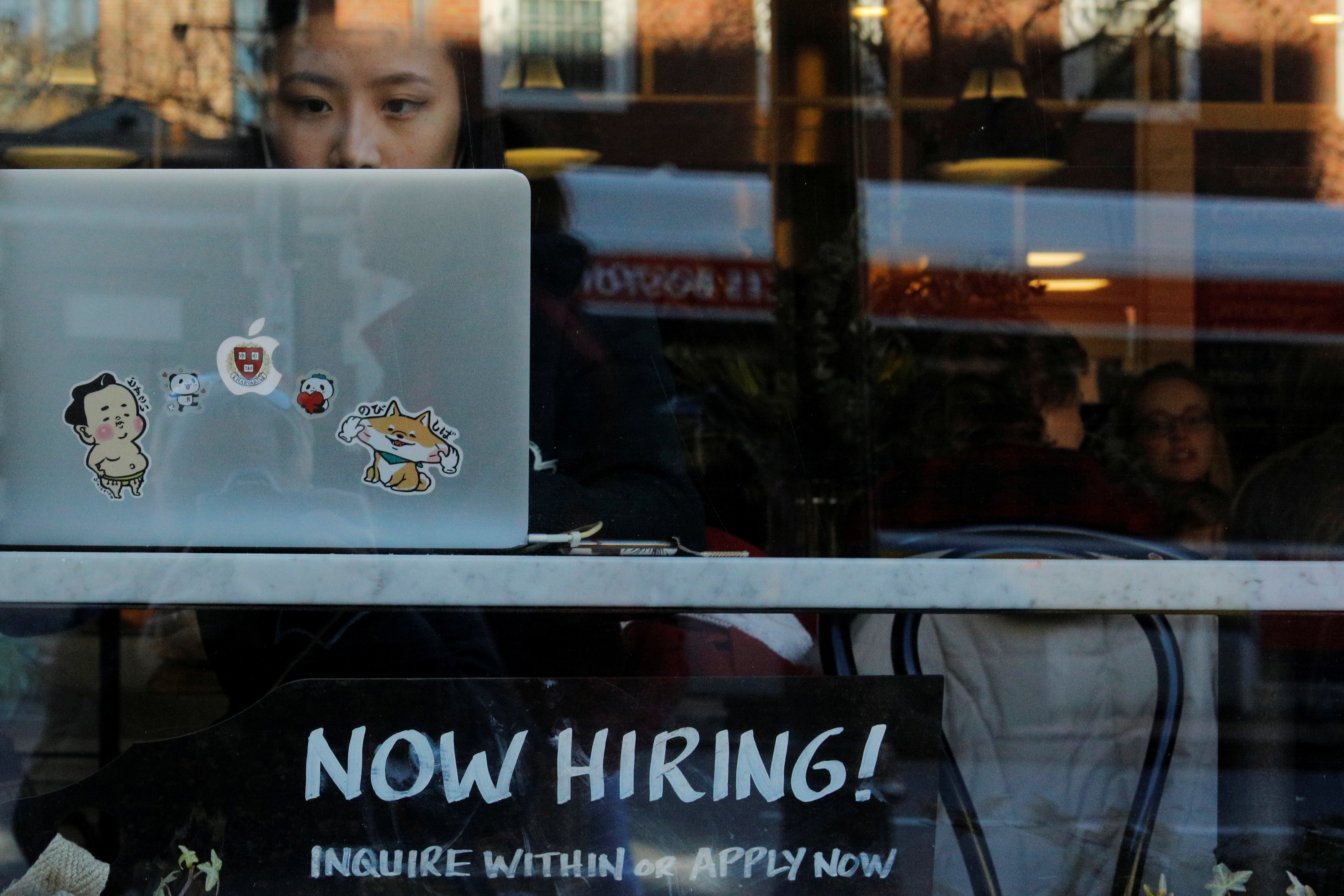 """A """"Now Hiring"""" sign sits in the window of Tatte Bakery and Cafe in Cambridge, Massachusetts, U.S., February 11, 2019.   REUTERS/Brian Snyder - RC179706A2B0"""