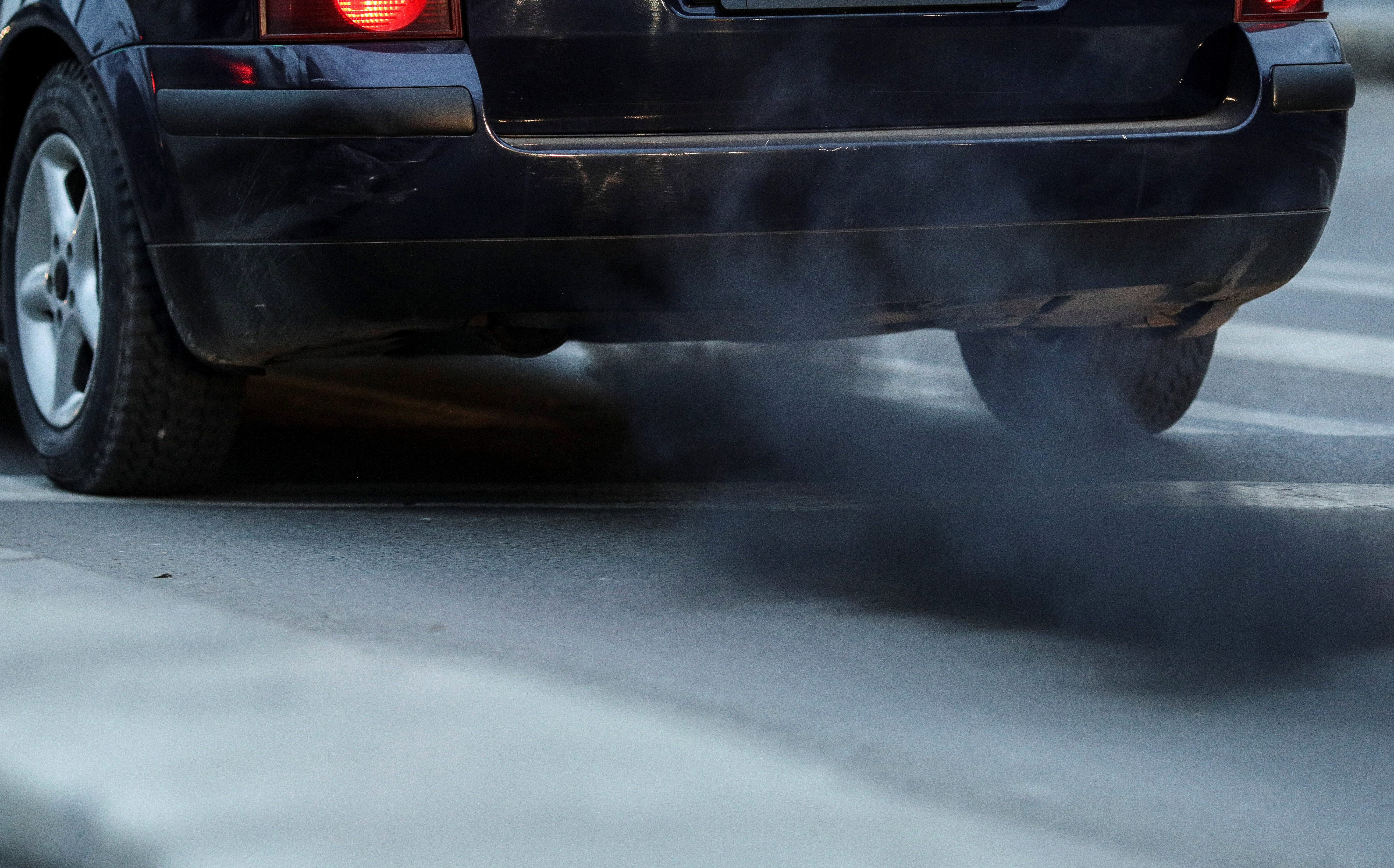 Image of a car spewing black exhaust smoke
