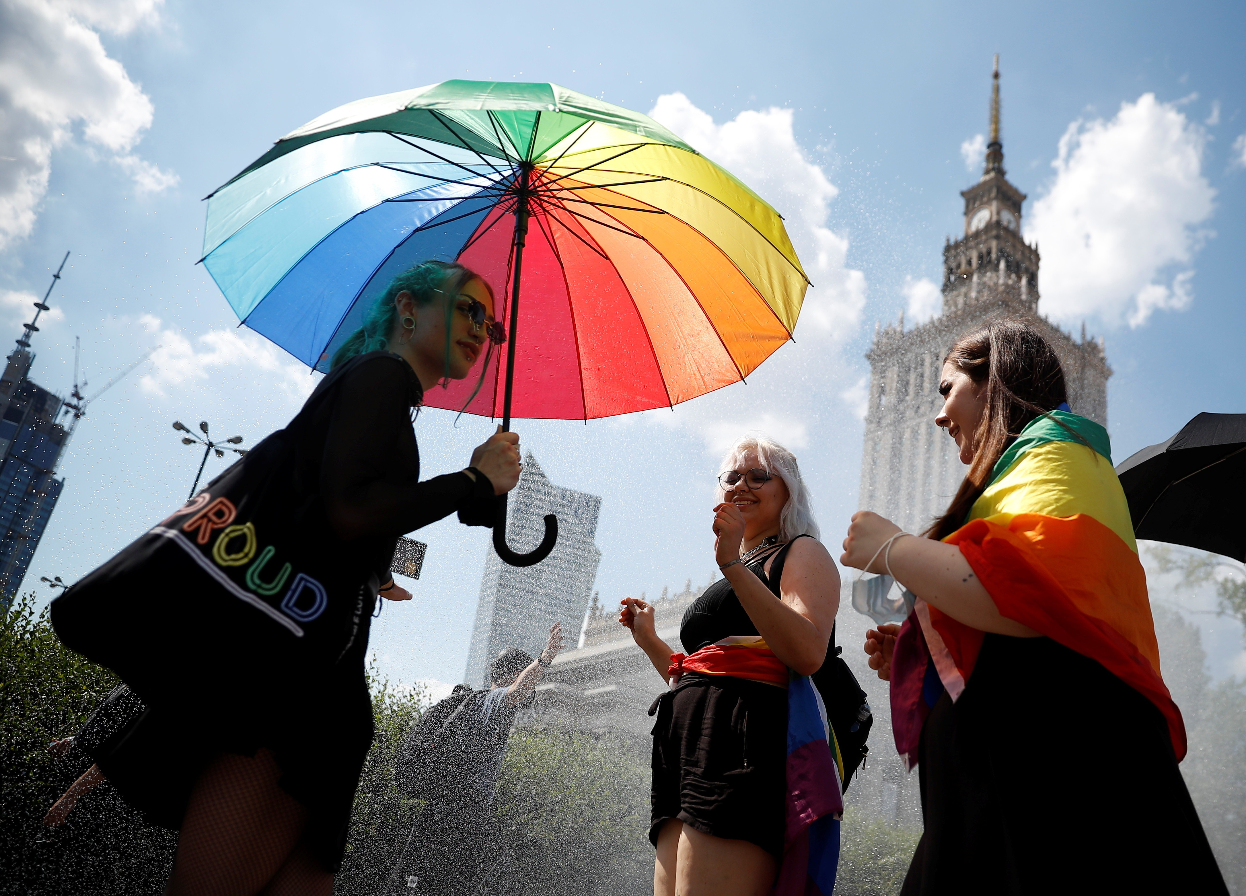 """People gather for the """"Equality Parade"""" rally in support of the LGBT community with multicoloured umbrellas, glasses and other accessories"""