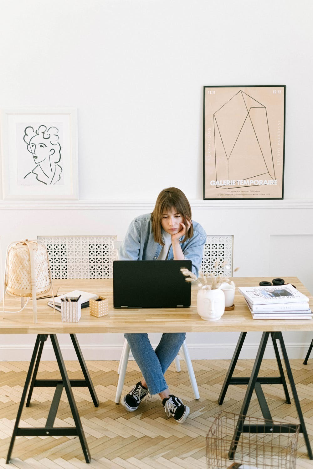 Woman sat at her desk working on laptop.