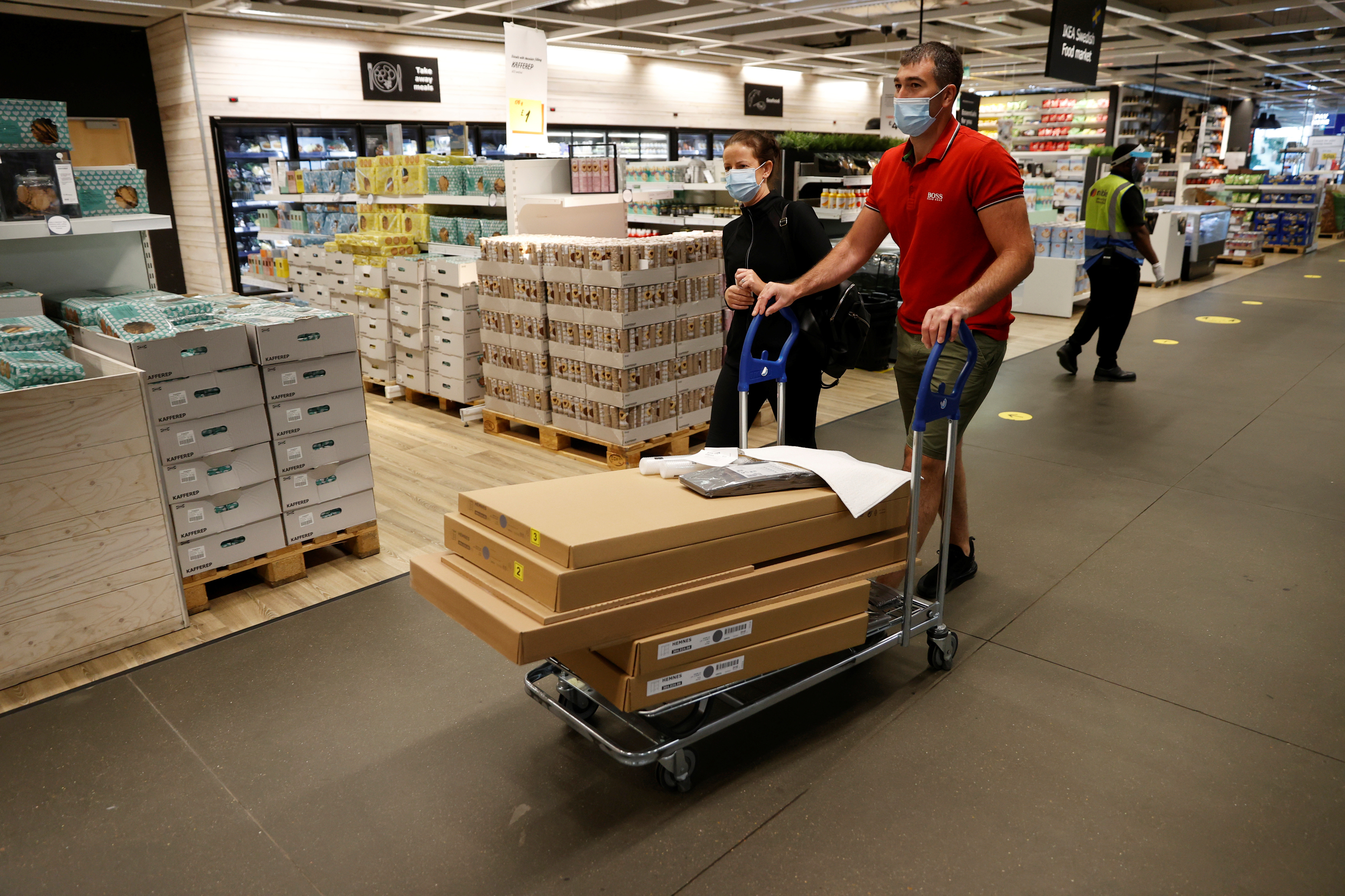 People wearing masks shop at Ikea in Tottenham as it re-opens, following the outbreak of the coronavirus disease (COVID-19), London, Britain, June 1, 2020. REUTERS/John Sibley - RC2A0H99S1LZ