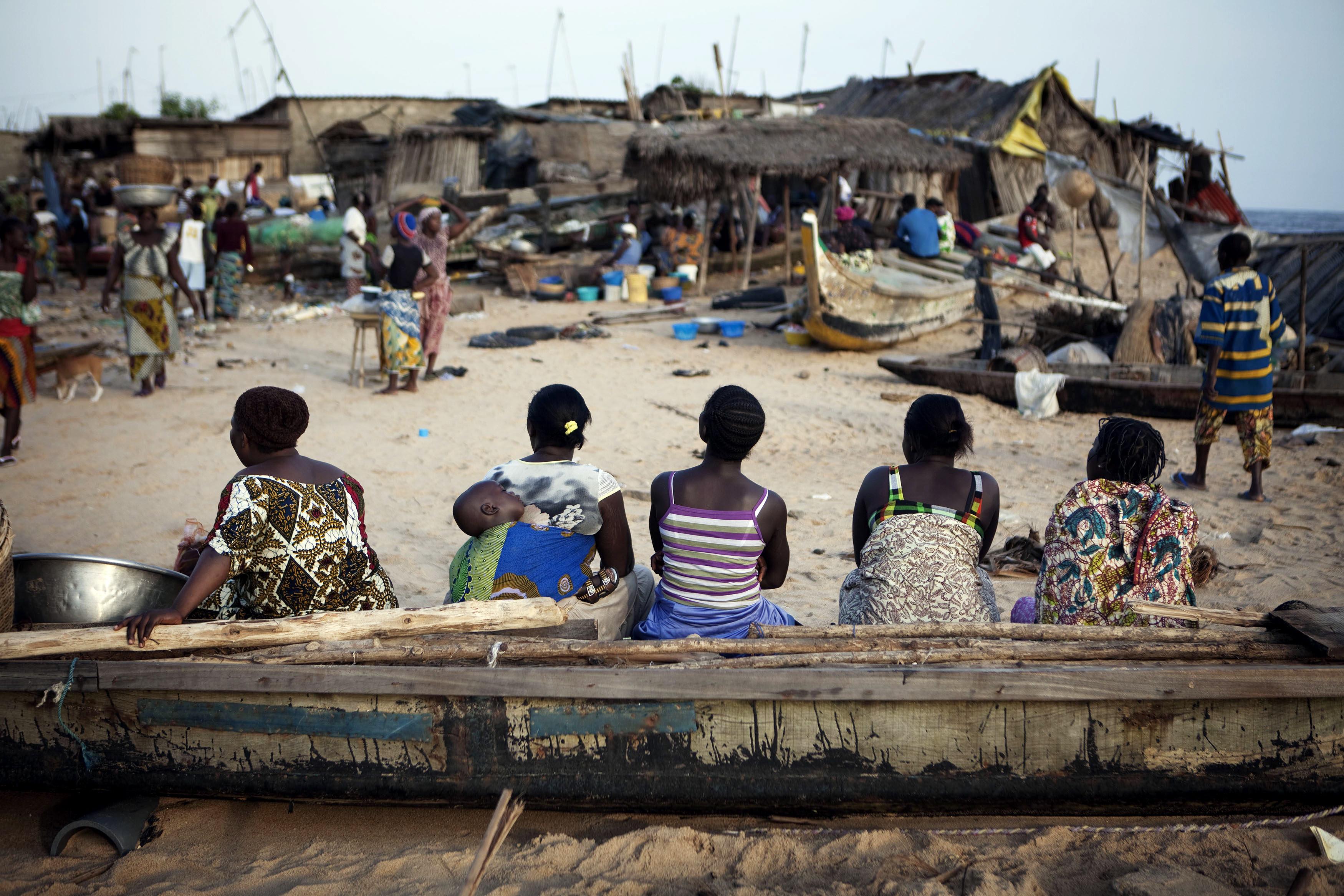 Women sit on a fishing boat in the Akpakpa neighbourhood of Benin's capital Cotonou