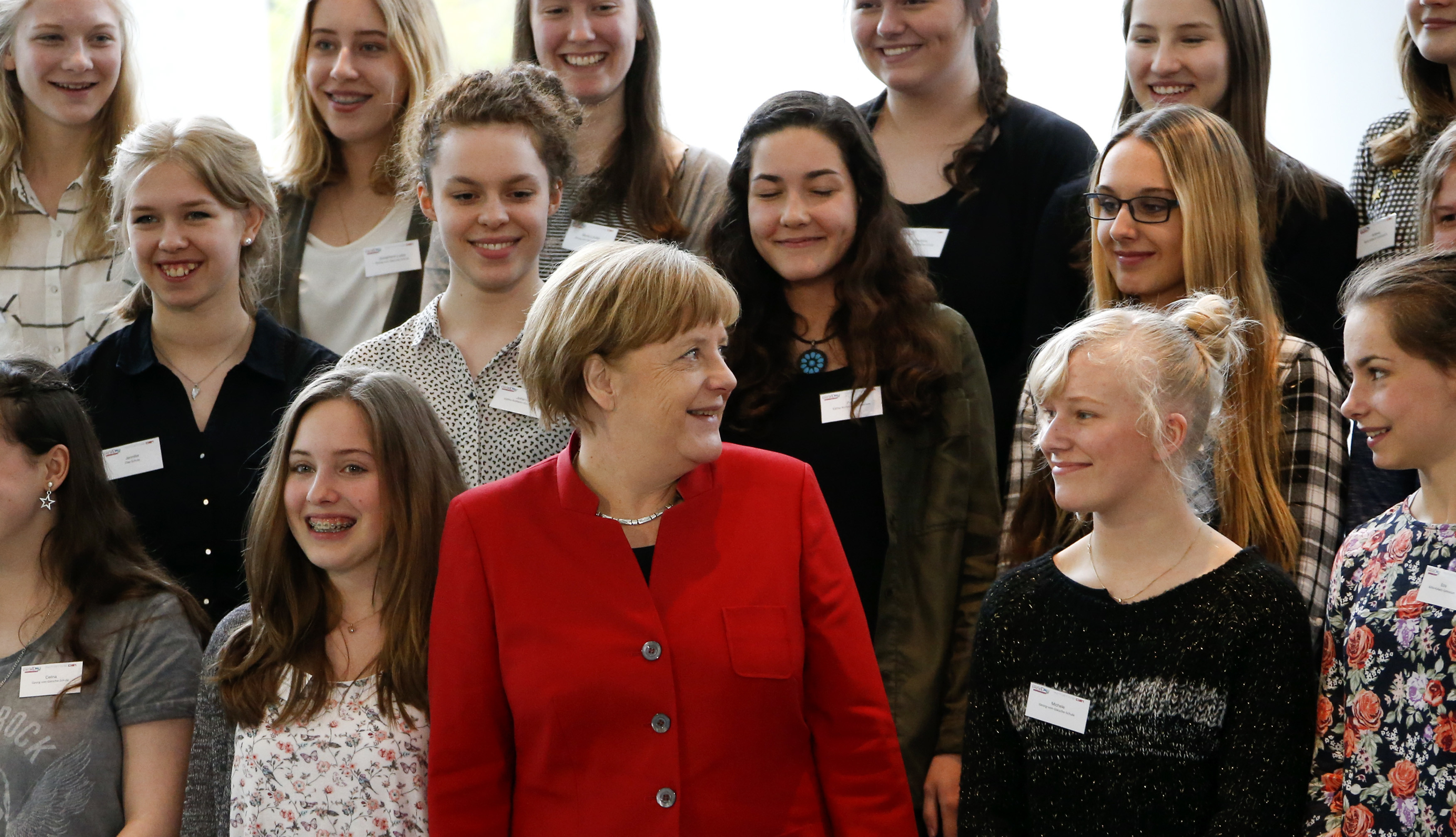 German Chancellor Angela Merkel poses with participants of a Girls Day career event at the Chancellery in Berlin April 27, 2016. Girls Day seeks to attract female pupils to careers in IT, technological and natural science sectors of the German industry.    REUTERS/Fabrizio Bensch - LR1EC4R0WO0RP