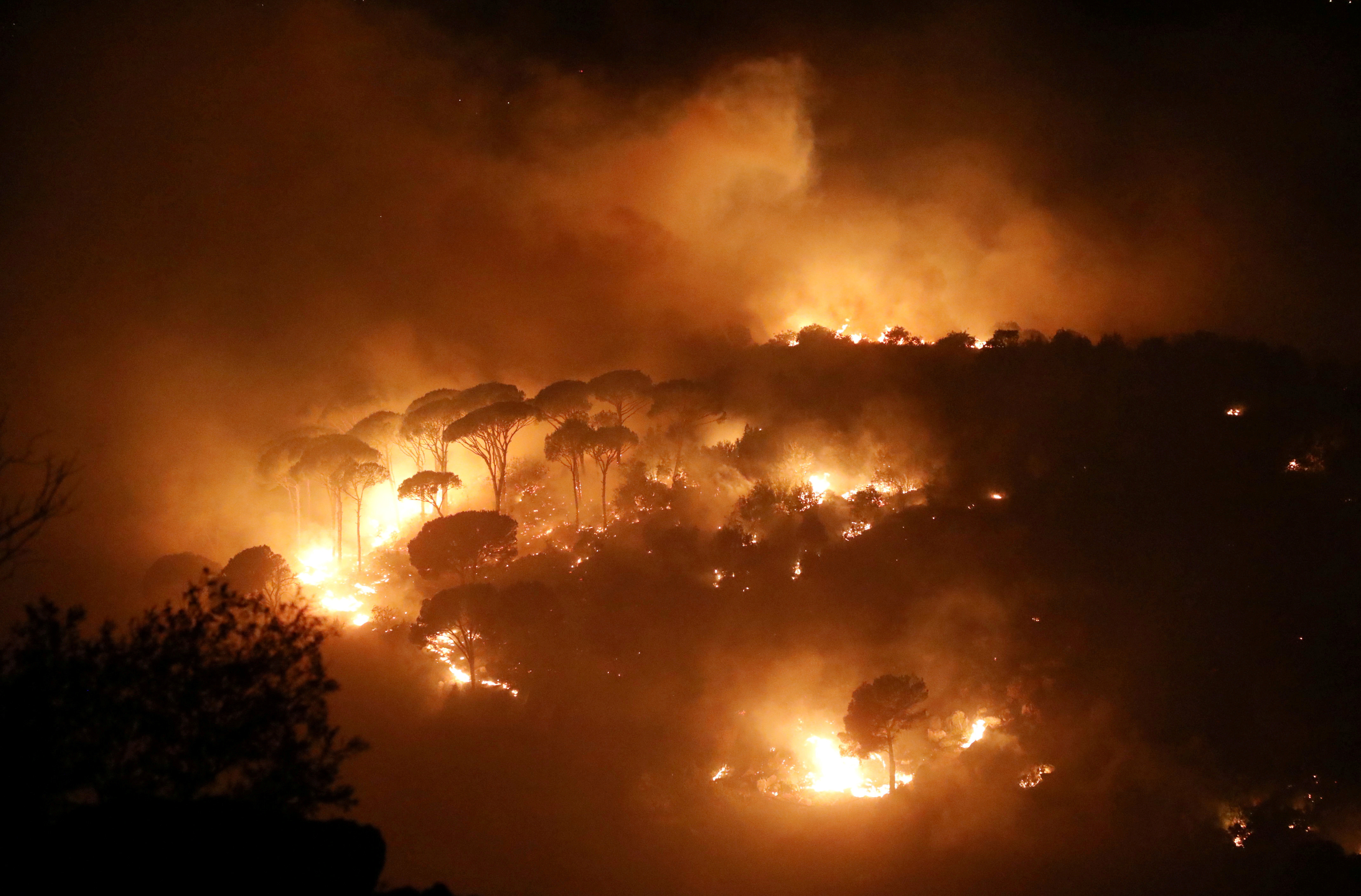Wildfires burn a forest in Chbaniyeh village, Lebanon October 9, 2020. Picture taken October 9, 2020. REUTERS/Mohamed Azakir     TPX IMAGES OF THE DAY - RC2JFJ9ISV4P