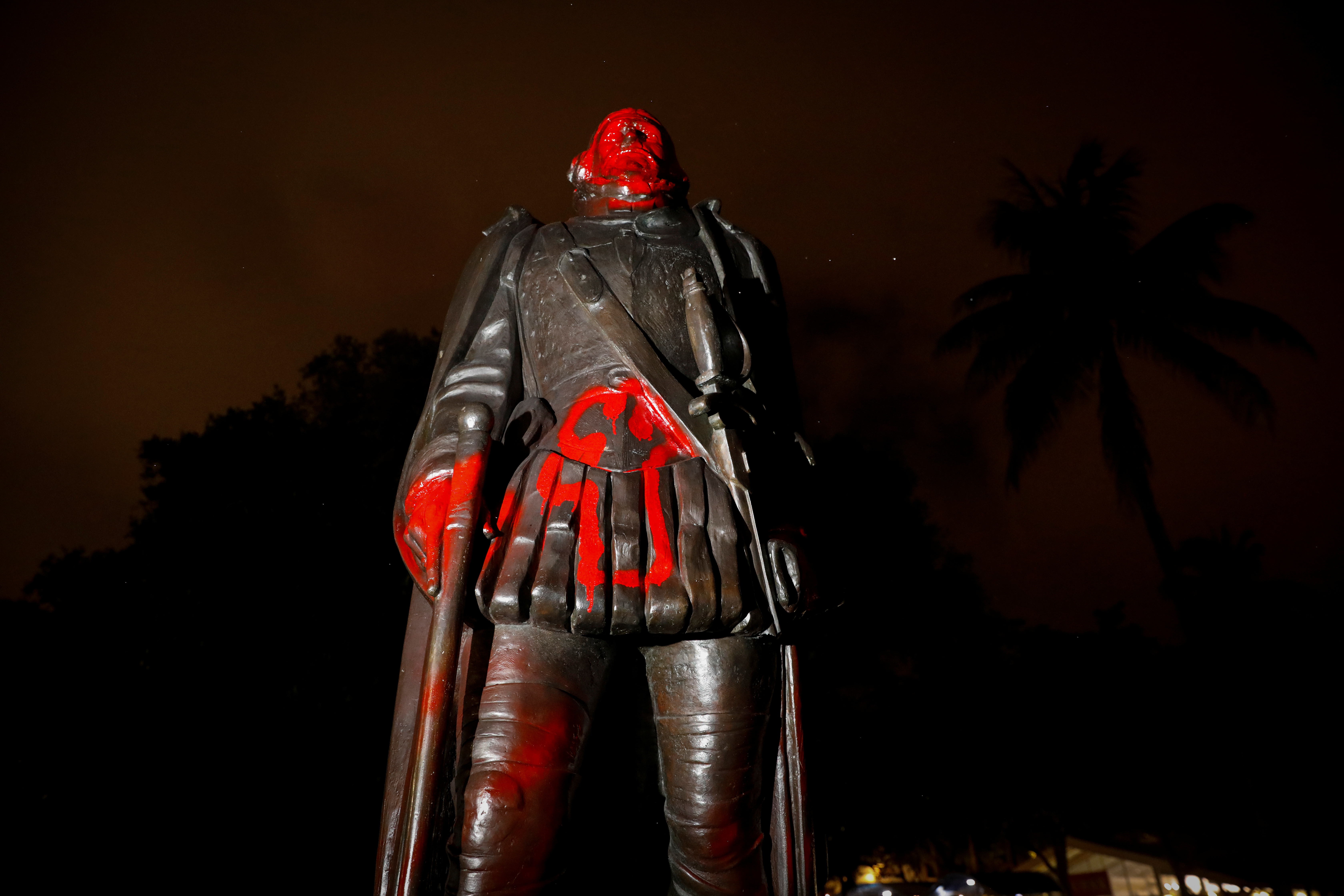 A vandalized statue of Christopher Columbus is seen at the Bayside Marketplace, after a protest against racial inequality in the aftermath of the death in Minneapolis police custody of George Floyd, in Downtown Miami, Florida, U.S., June 10, 2020. REUTERS/Marco Bello - RC2S6H948OKT