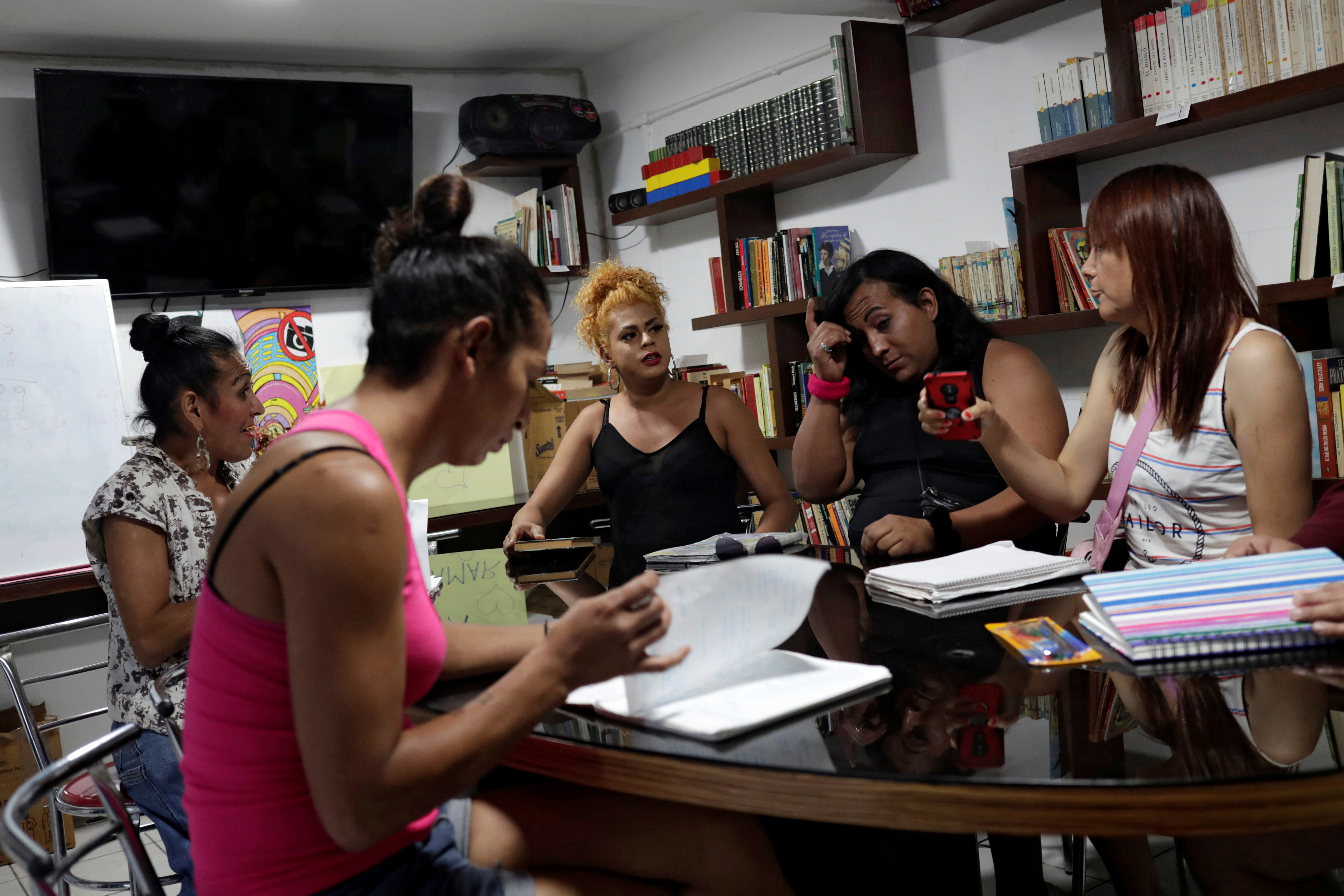 Transgender Mexicans speak inside a study room in a shelter, after the hotels where they were residing shut down during the pandemic.