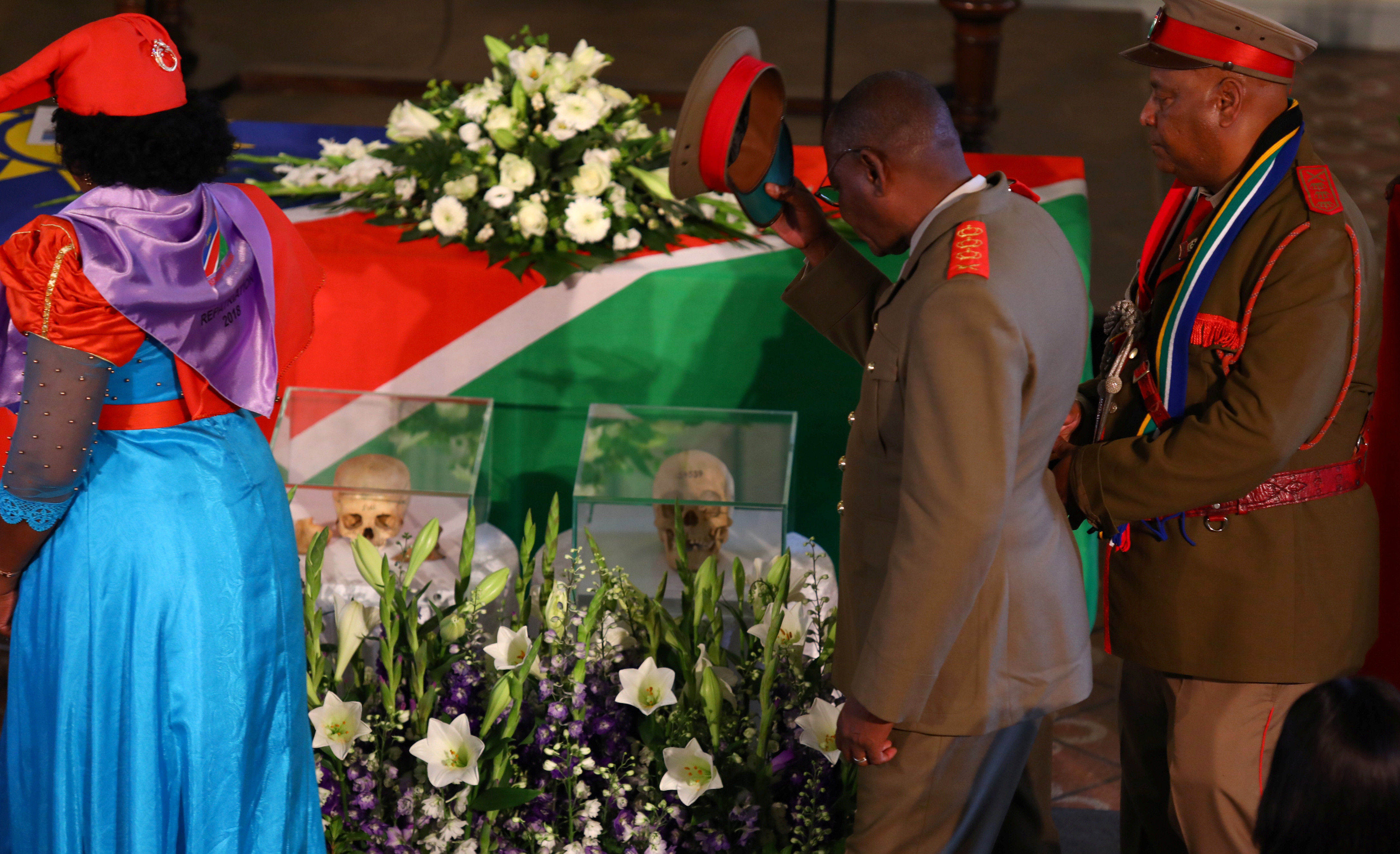 Members of a delegation attend a ceremony in Berlin, Germany, August 29, 2018, to hand back human remains from Germany to Namibia following the 1904-1908 genocide against the Herero and Nama