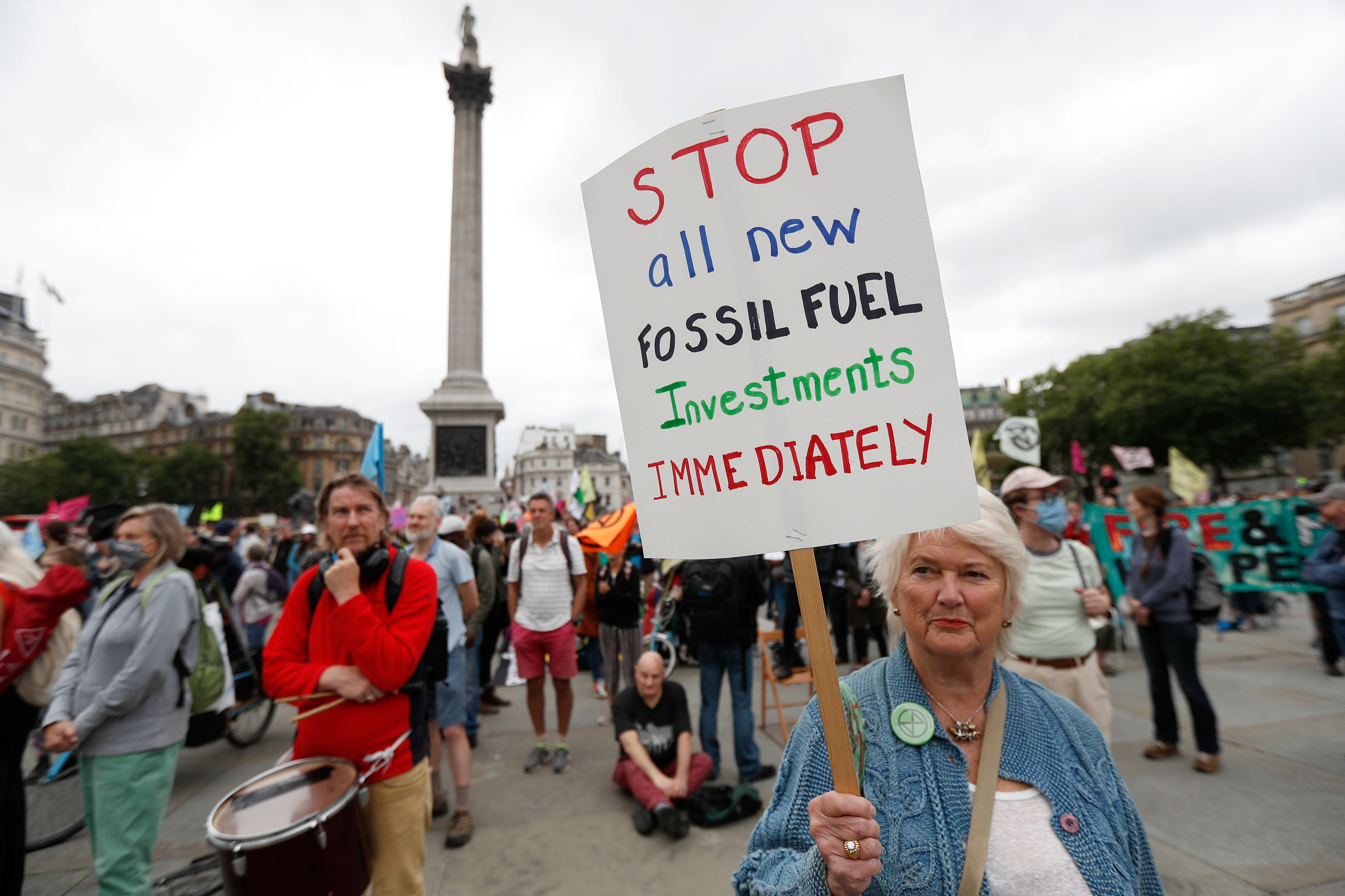 A demonstrator holds a sign during a protest of Extinction Rebellion climate activists at Trafalgar Square, in London, Britain August 23, 2021. REUTERS/Peter Nicholls - RC2XAP9QT57K