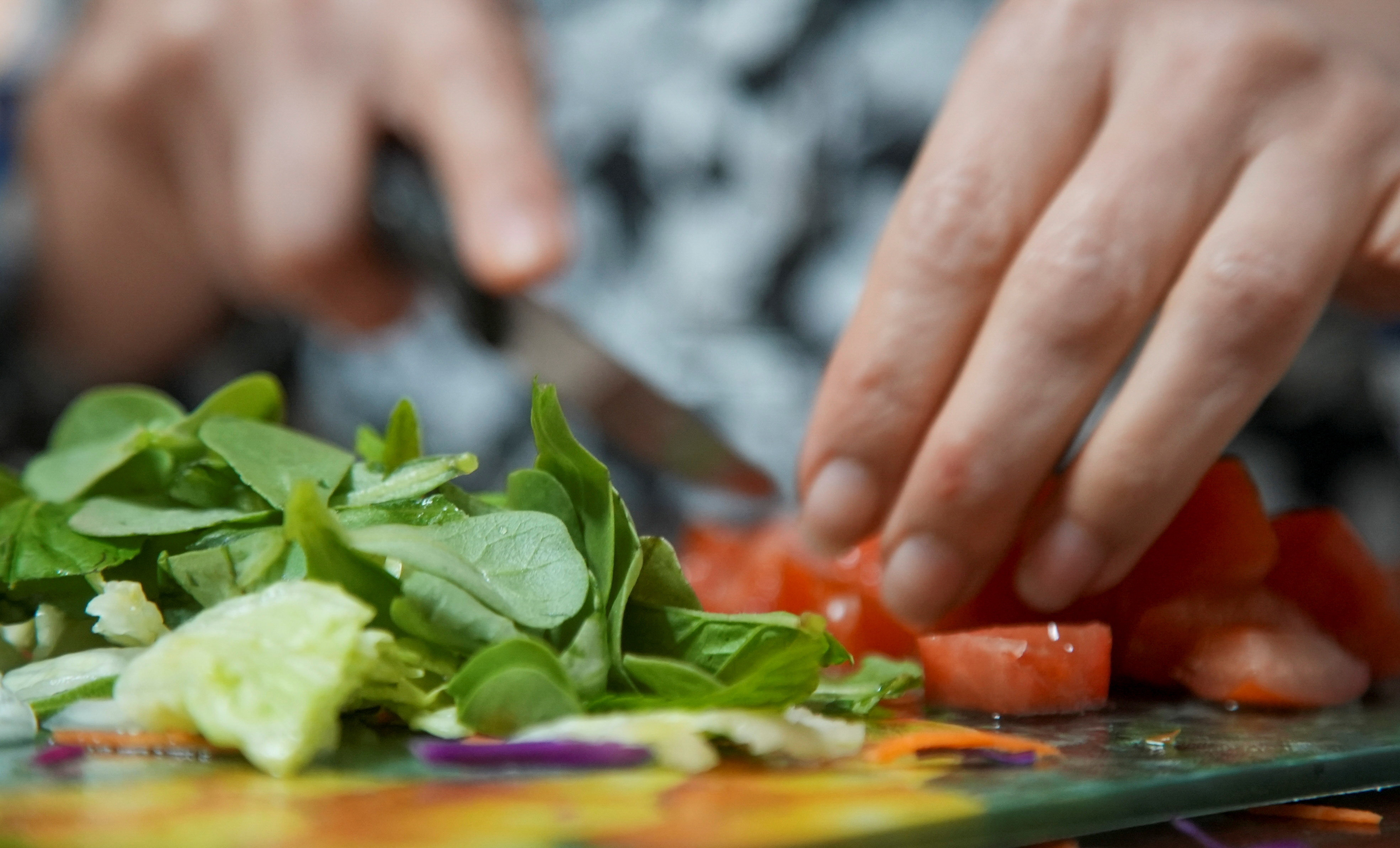 a close up of a leafy salad being prepared