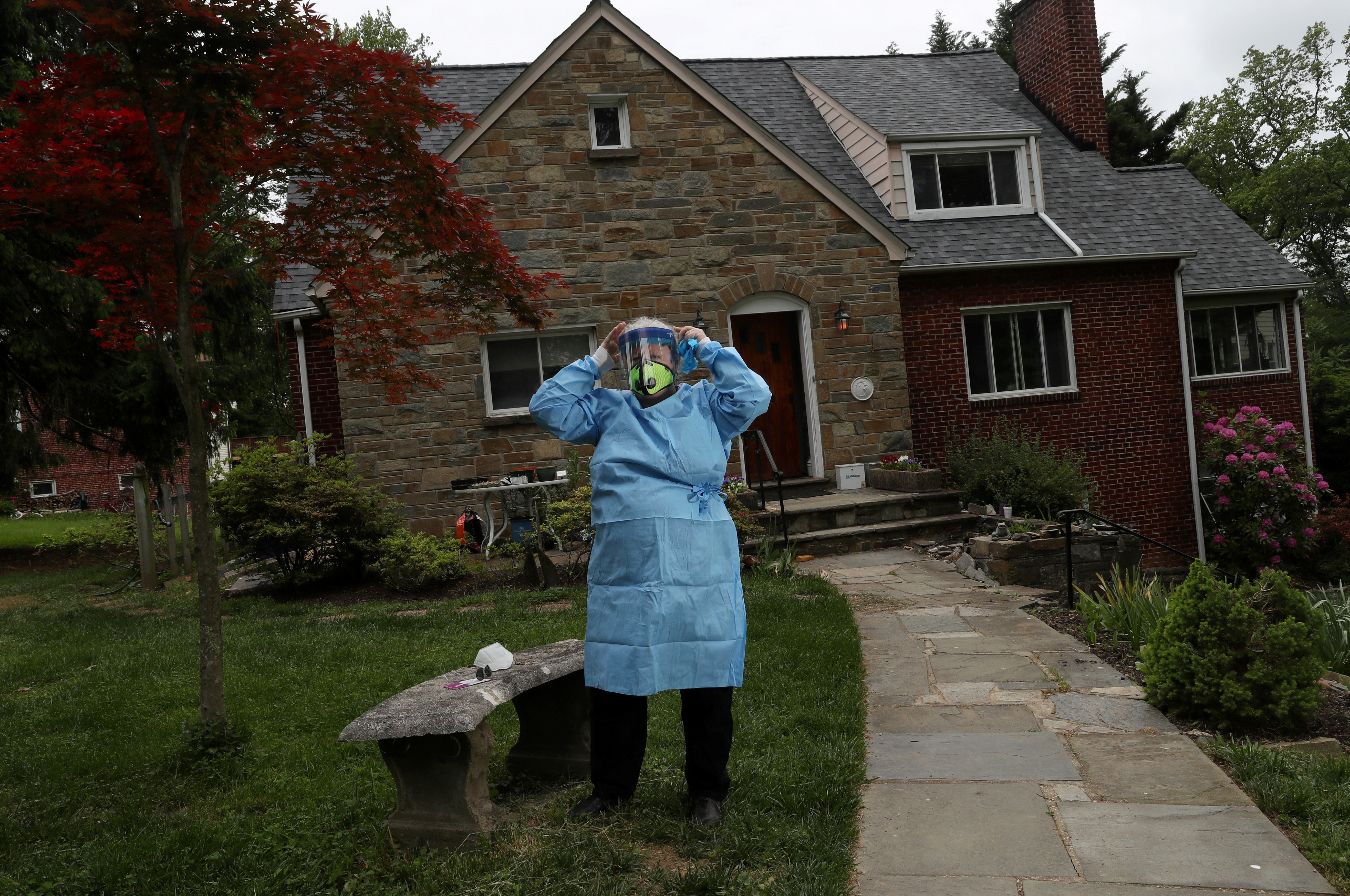 Mairi Breen Rothman, CNM, DM. Certified Nurse-Midwife. Director, M.A.M.A.S., Inc. poses for a portrait in Takoma Park, U.S., May 17, 2020. Picture taken May 17, 2020. REUTERS/Leah Millis - RC2P3J91P8UA
