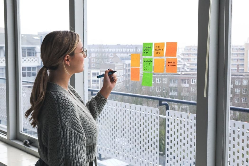 image of a woman brainstorming ideas in an office