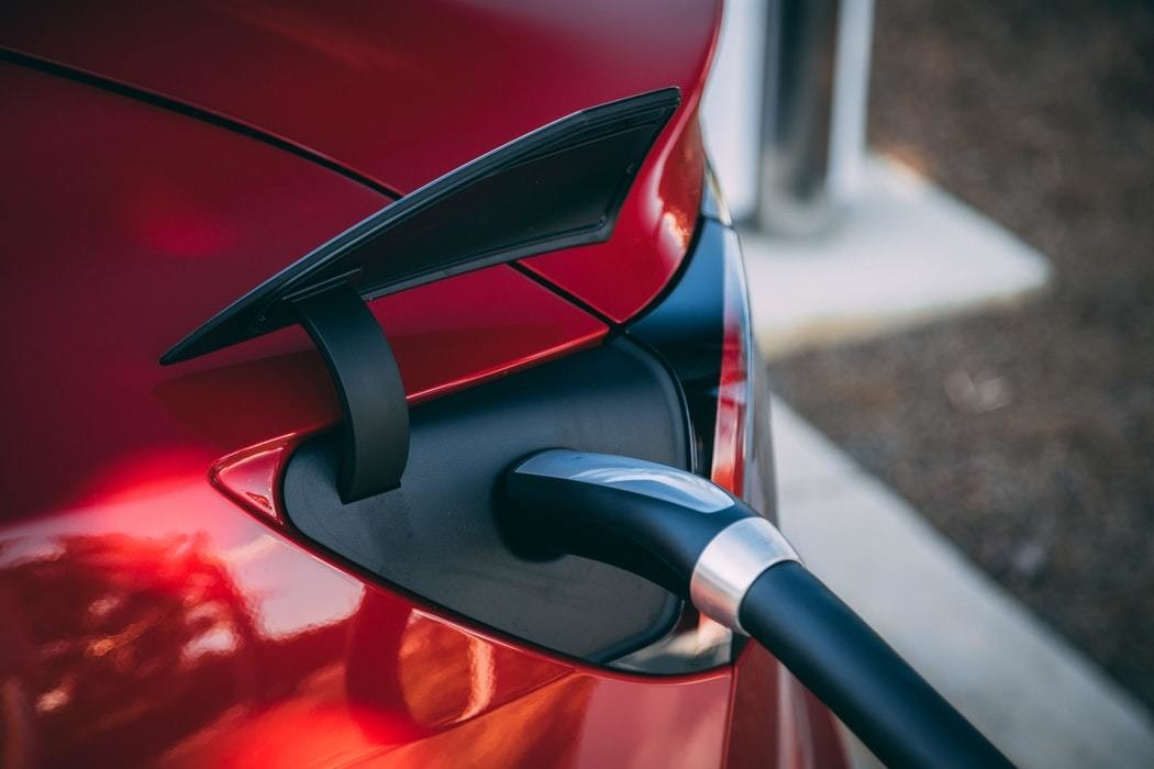 image of an electric car being charged