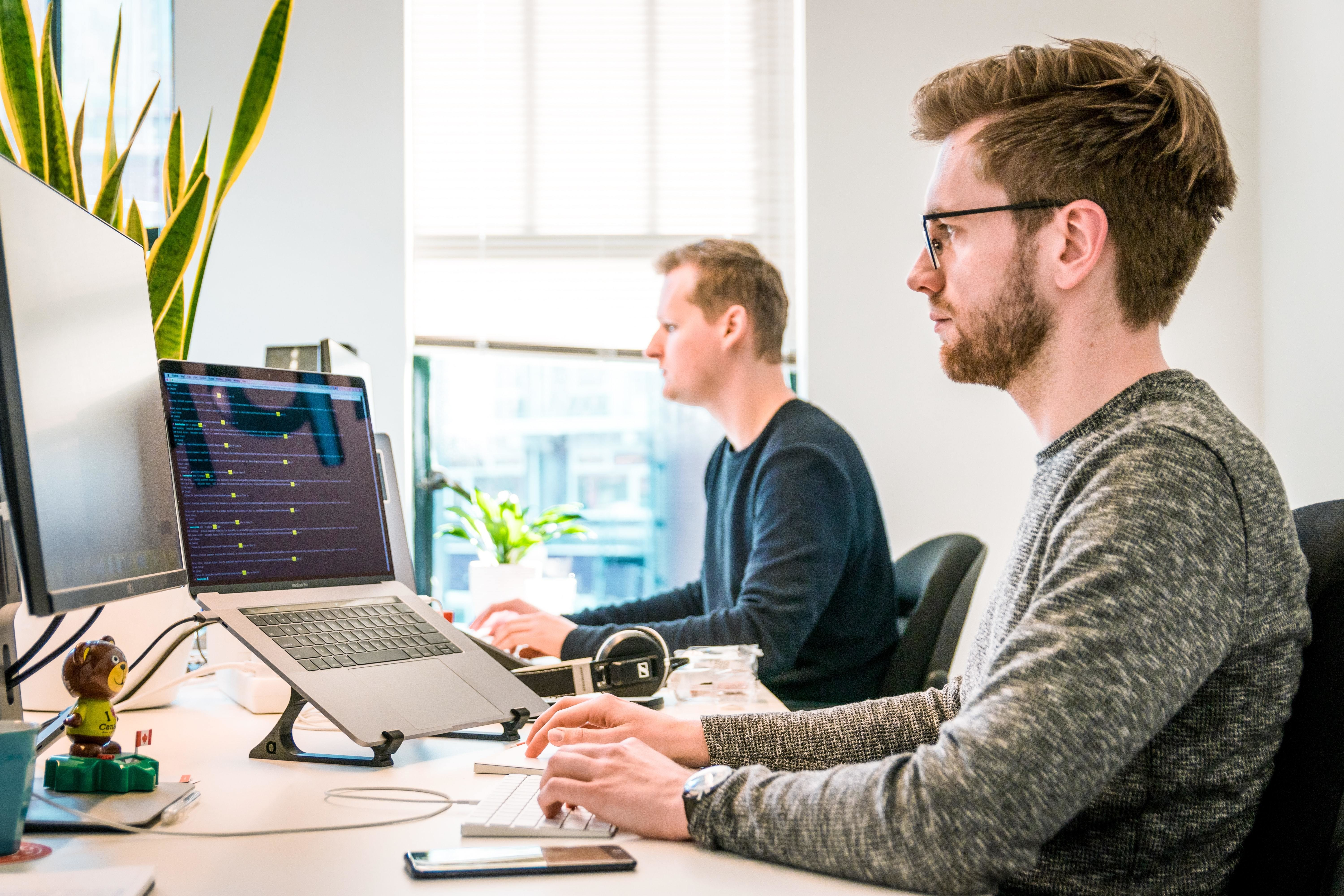 image of two men working in an office