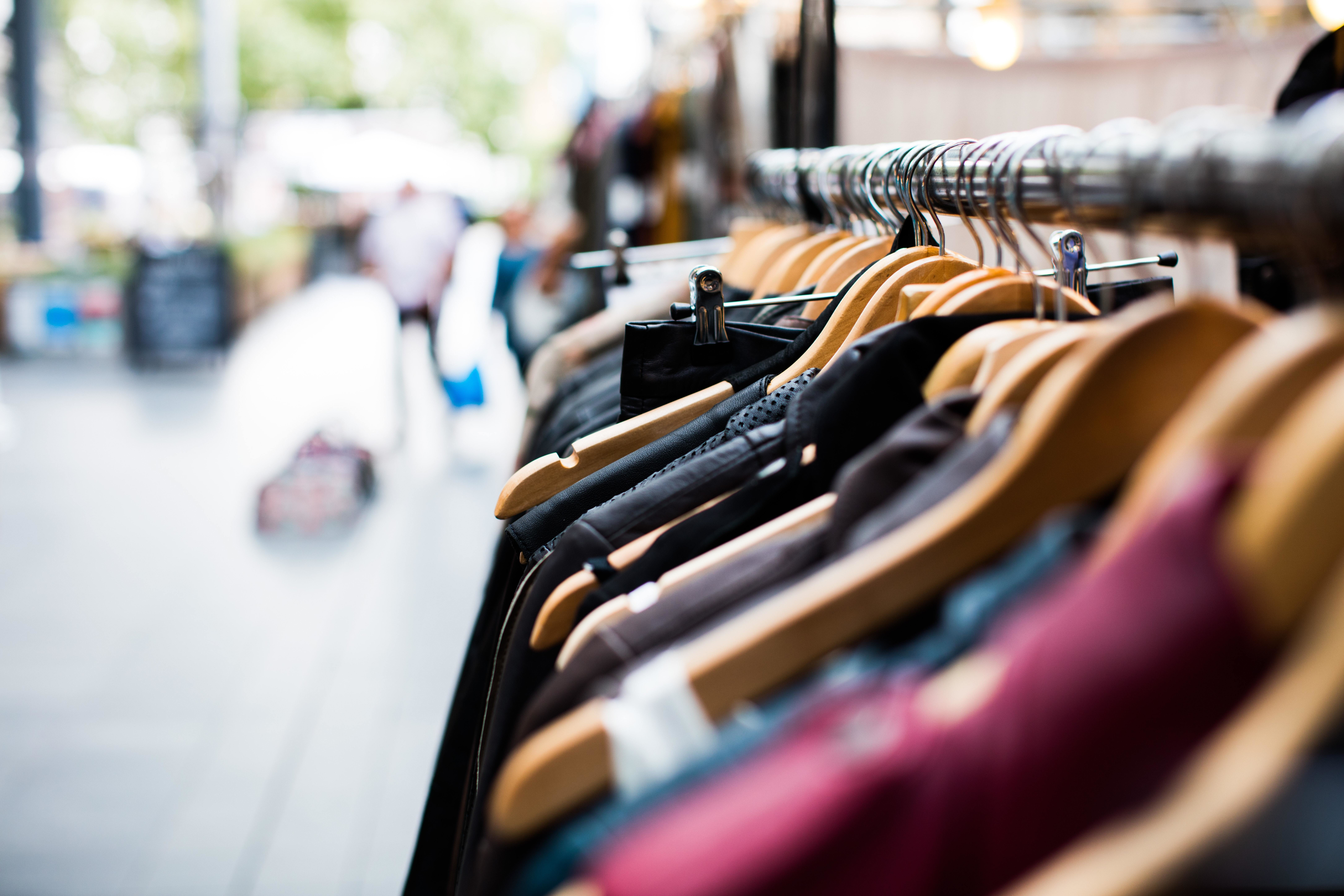 the retail sector, shown here with a rack of clothes, was hit particularly hard during COVID-19, which affected women who were more likely to be working in this sector