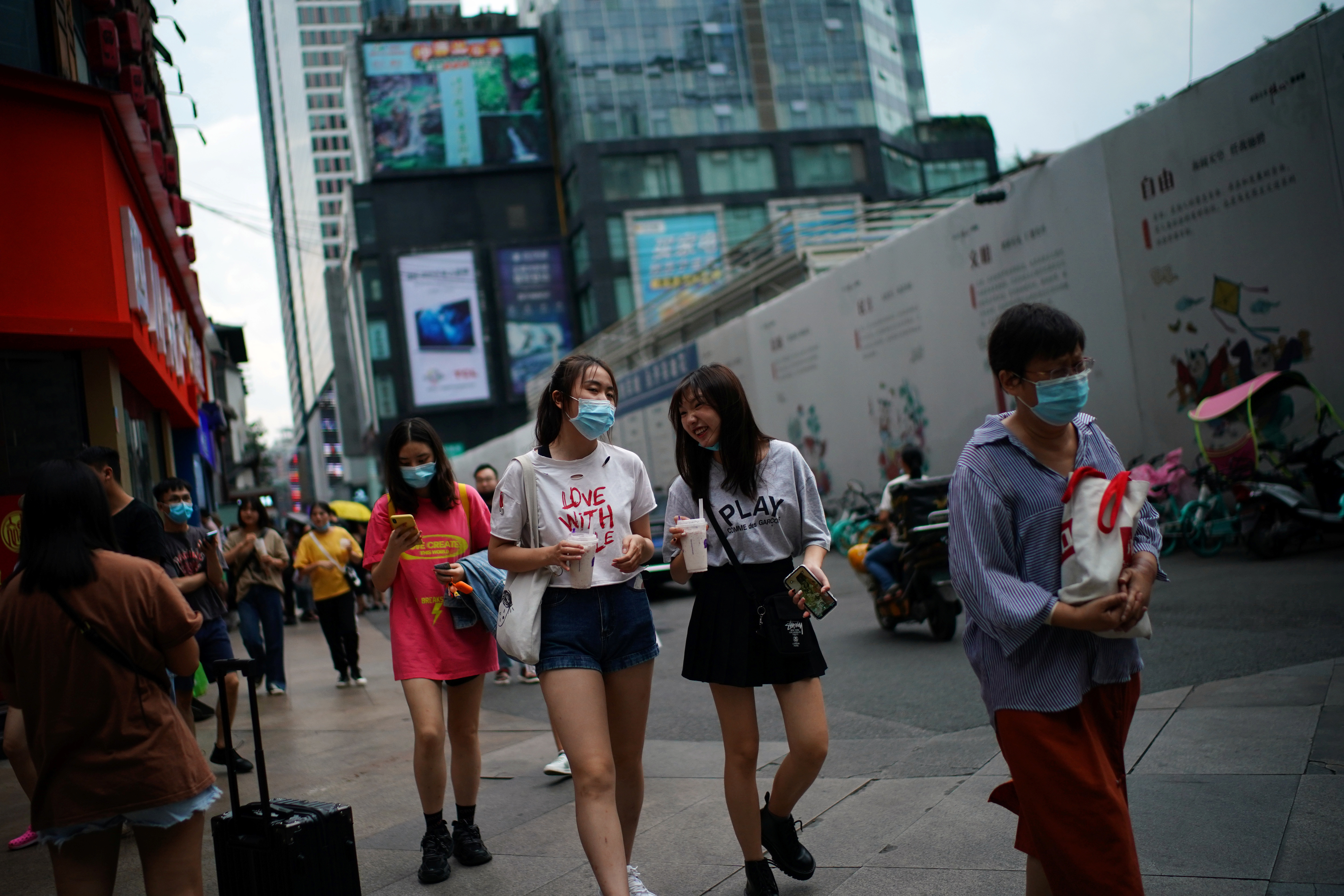 People wearing face masks walk at a shopping area following the coronavirus disease (COVID-19) outbreak, in Chengdu, Sichuan province, China September 8, 2020. REUTERS/Tingshu Wang - RC28UI9IP72W