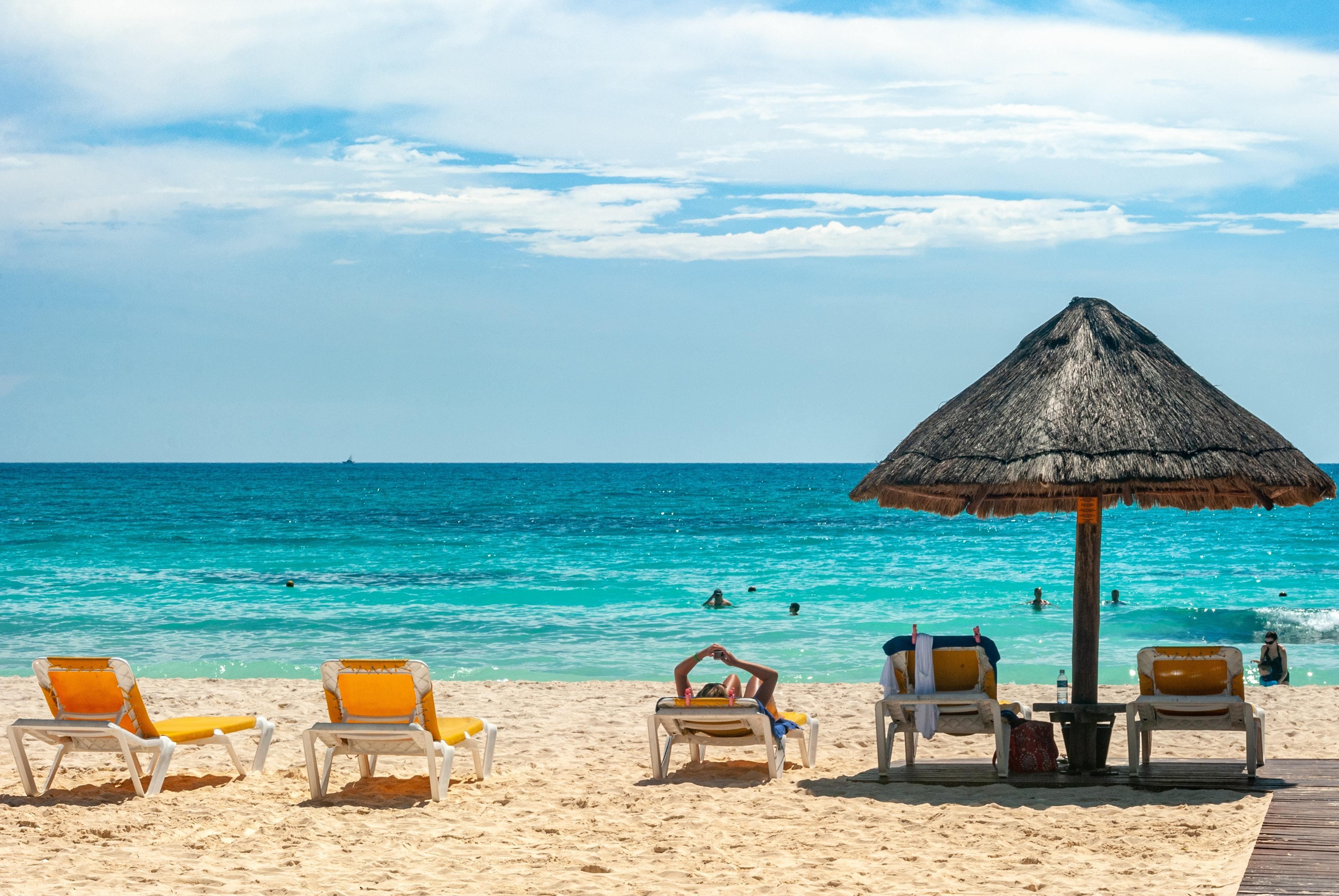 A man lying on a sunny beach.
