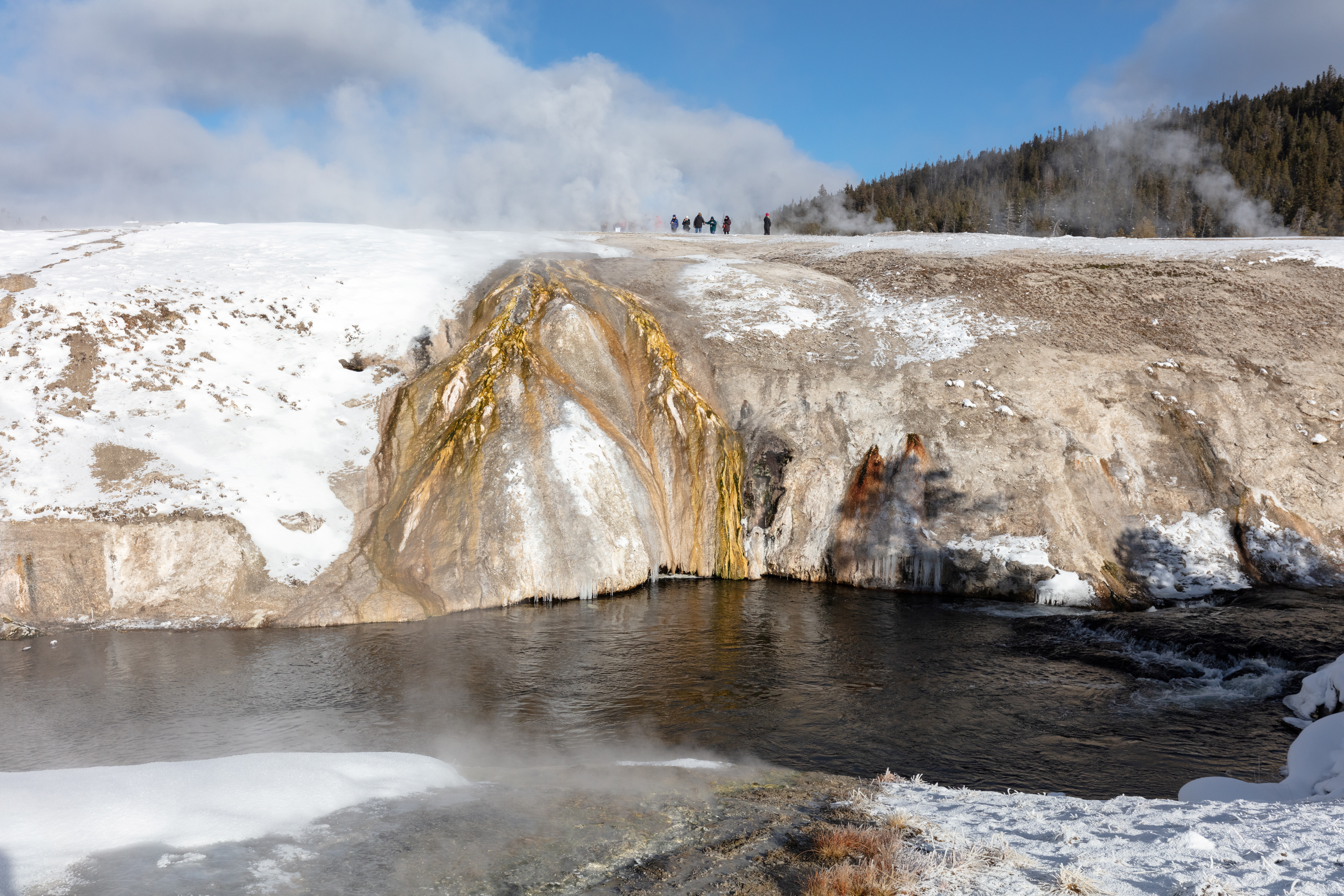 A tour group is seen on Geyser Hill Boardwalks at Yellowstone National Park in Wyoming, U.S., January 28, 2019.