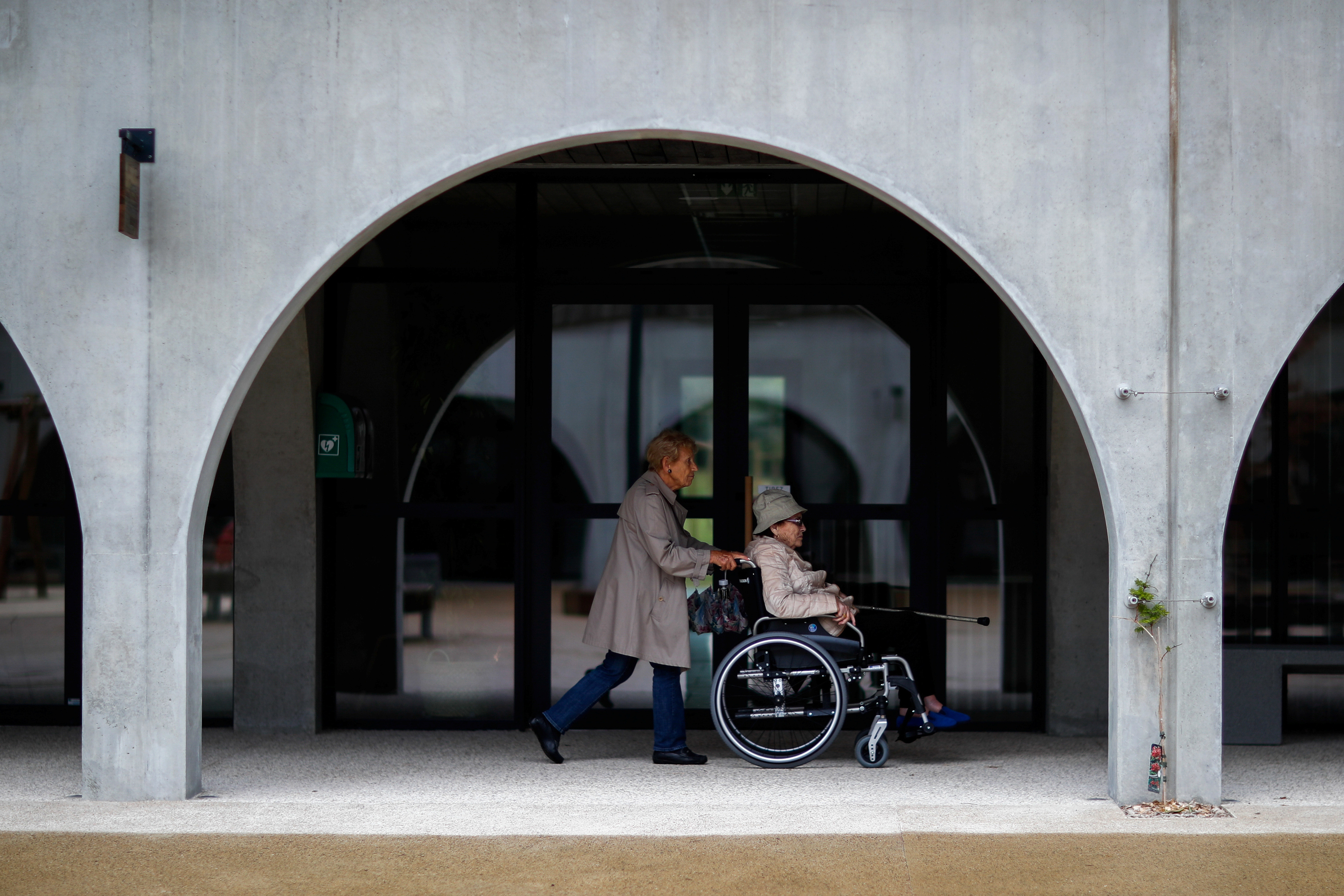 Alzheimer's patients Marie-Christiane pushes Jaqueline, 92, on her wheelchair during a walk at the Village Landais Alzheimer site in Dax, France, September 24, 2020. Picture taken on September 24, 2020. REUTERS/Gonzalo Fuentes - RC2K9J95H3ST