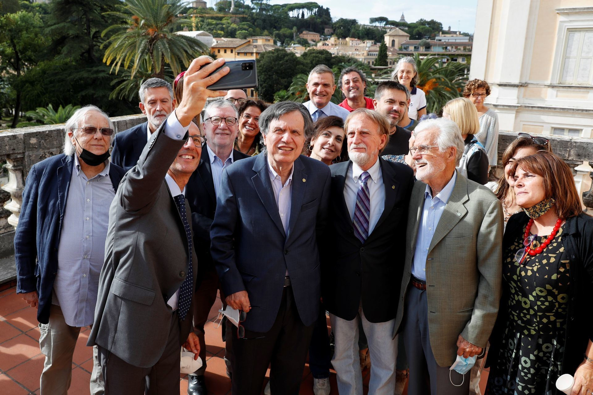 Joint winner of the Nobel Prize for Physics, Italian scientist Giorgio Parisi takes a selfie with his colleagues after the announcement in Rome, Italy, October 5, 2021.