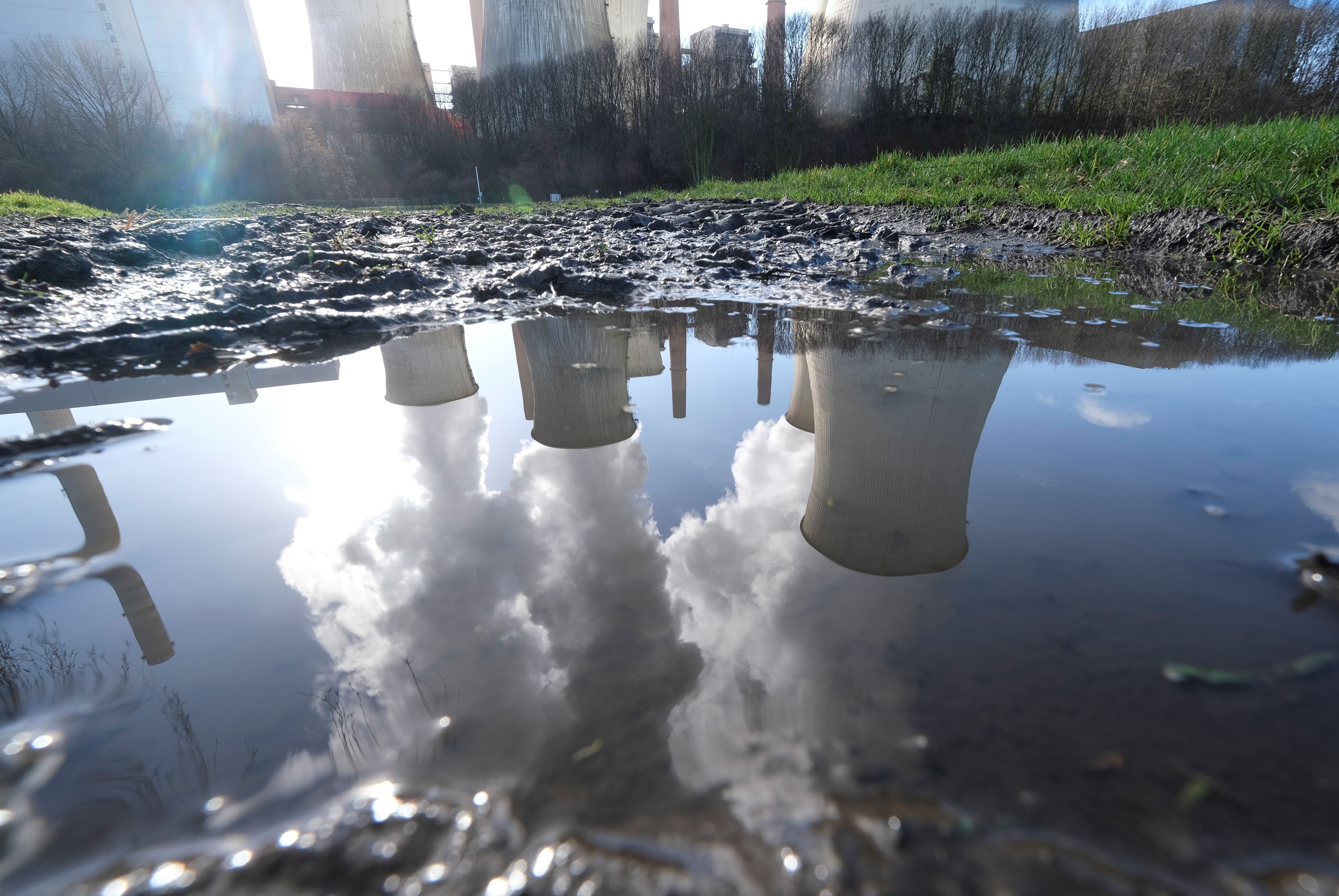 The lignite power plant complex of German energy supplier and utility RWE is reflected in a puddle in Neurath, north-west of Cologne, Germany, February 5, 2020.    REUTERS/Wolfgang Rattay - RC2HUE9AAF4K