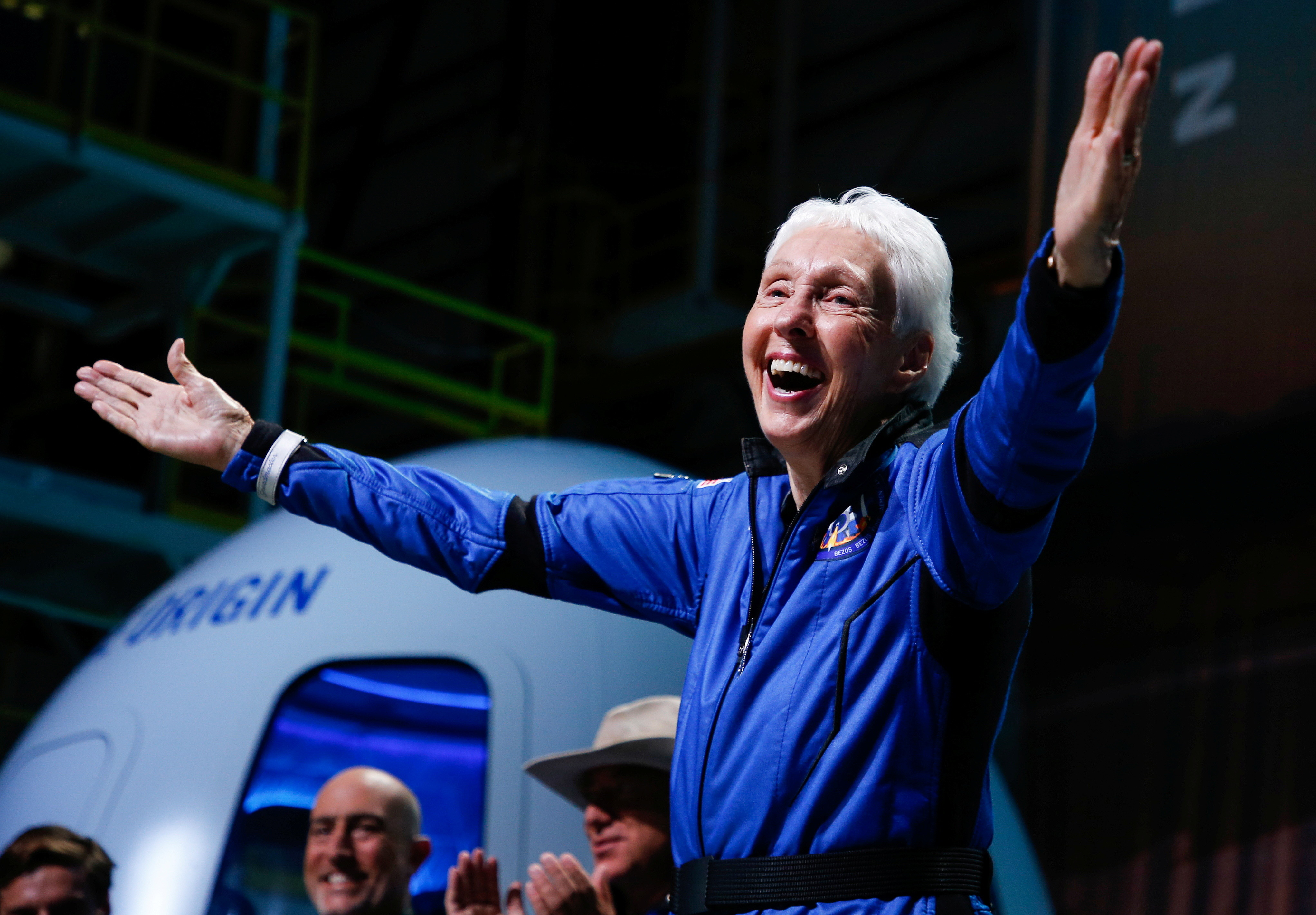 Wally Funk reacts after receiving her astronaut's wings from Blue Origin's Jeff Ashby, a former space shuttle commander at a post-launch press conference after she flew with three crewmates on Blue Origin's inaugural flight to the edge of space.
