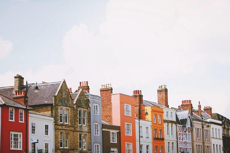 A row of houses on a street.