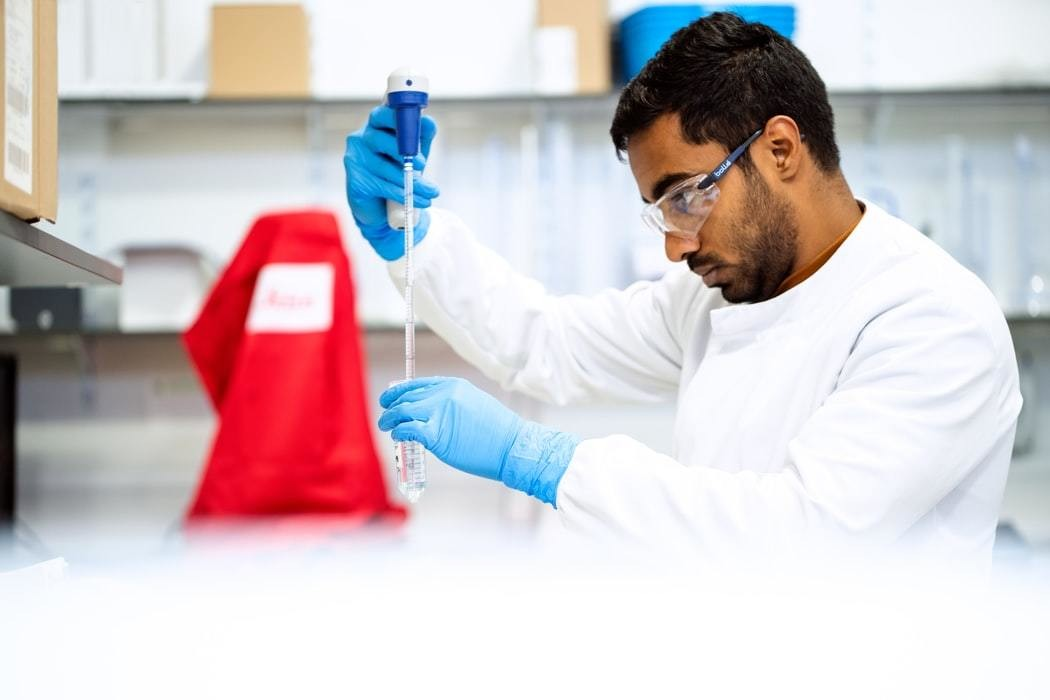 image of a scientist or academic doing an experiment