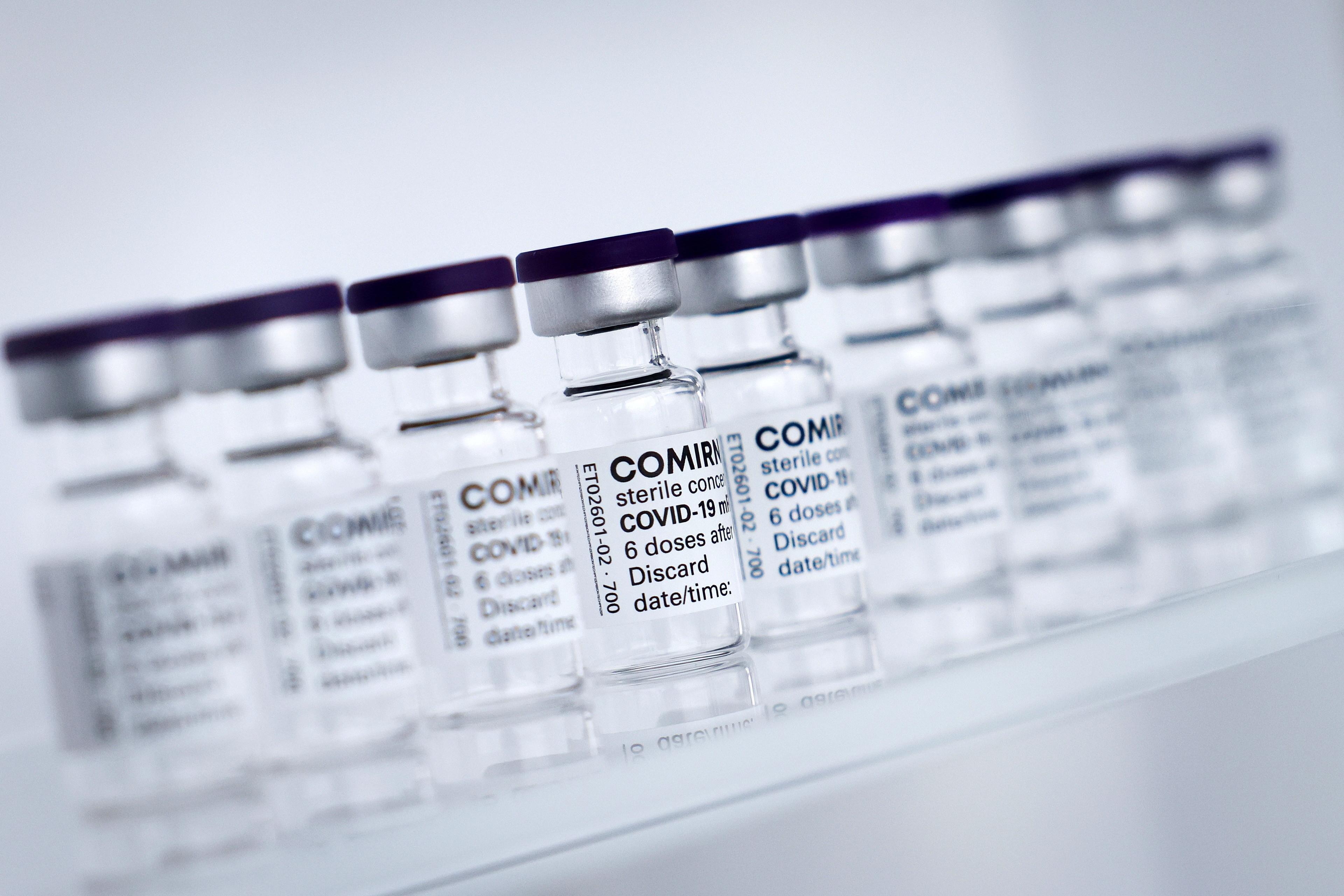 Empty vials of Pfizer/BioNTech's Comirnaty vaccine.