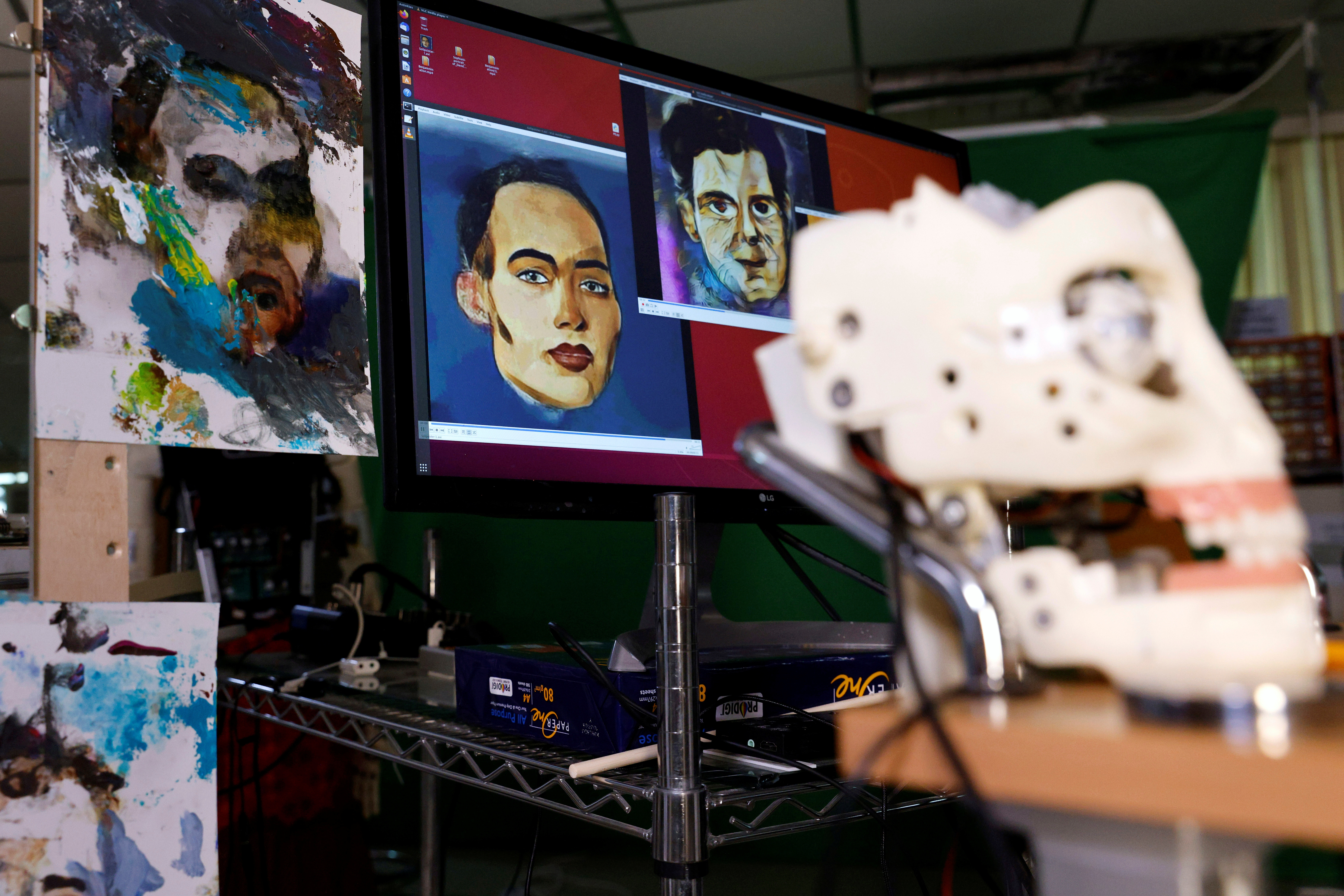 Digital artwork by humanoid robot Sophia, developed by Hanson Robotics, are seen at her studio before her non-fungible token (NFT) artwork is auctioned, in Hong Kong, China March 16, 2021. Picture taken March 16, 2021. REUTERS/Tyrone Siu - RC25GM9F3OM7