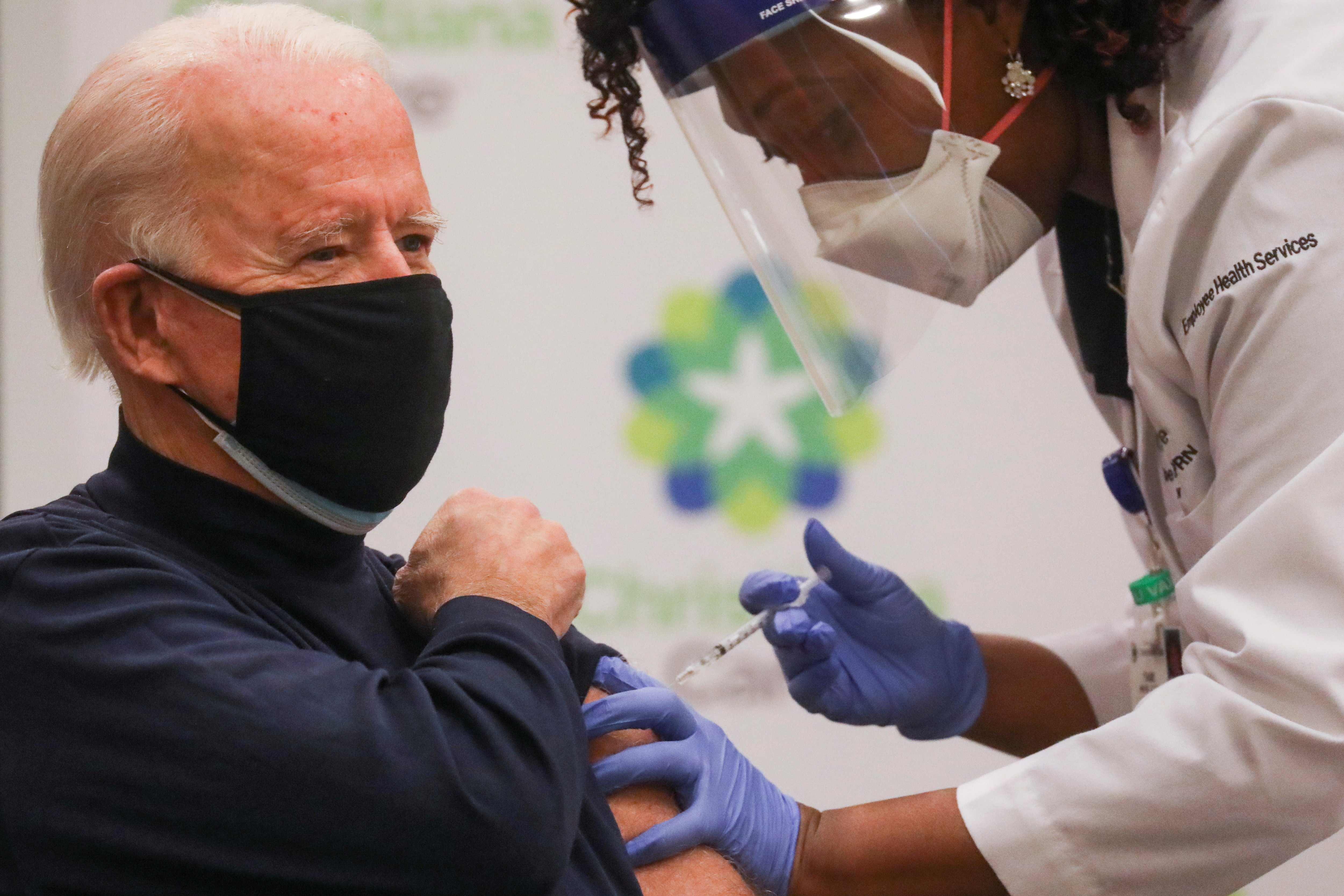 Nurse practitioner Tabe Mase gives U.S. President-elect Joe Biden a dose of a vaccine against the coronavirus disease (COVID-19) at ChristianaCare Christiana Hospital, in Newark, Delaware, U.S. December 21, 2020. REUTERS/Leah Millis     TPX IMAGES OF THE DAY - RC2WRK99XL3Q